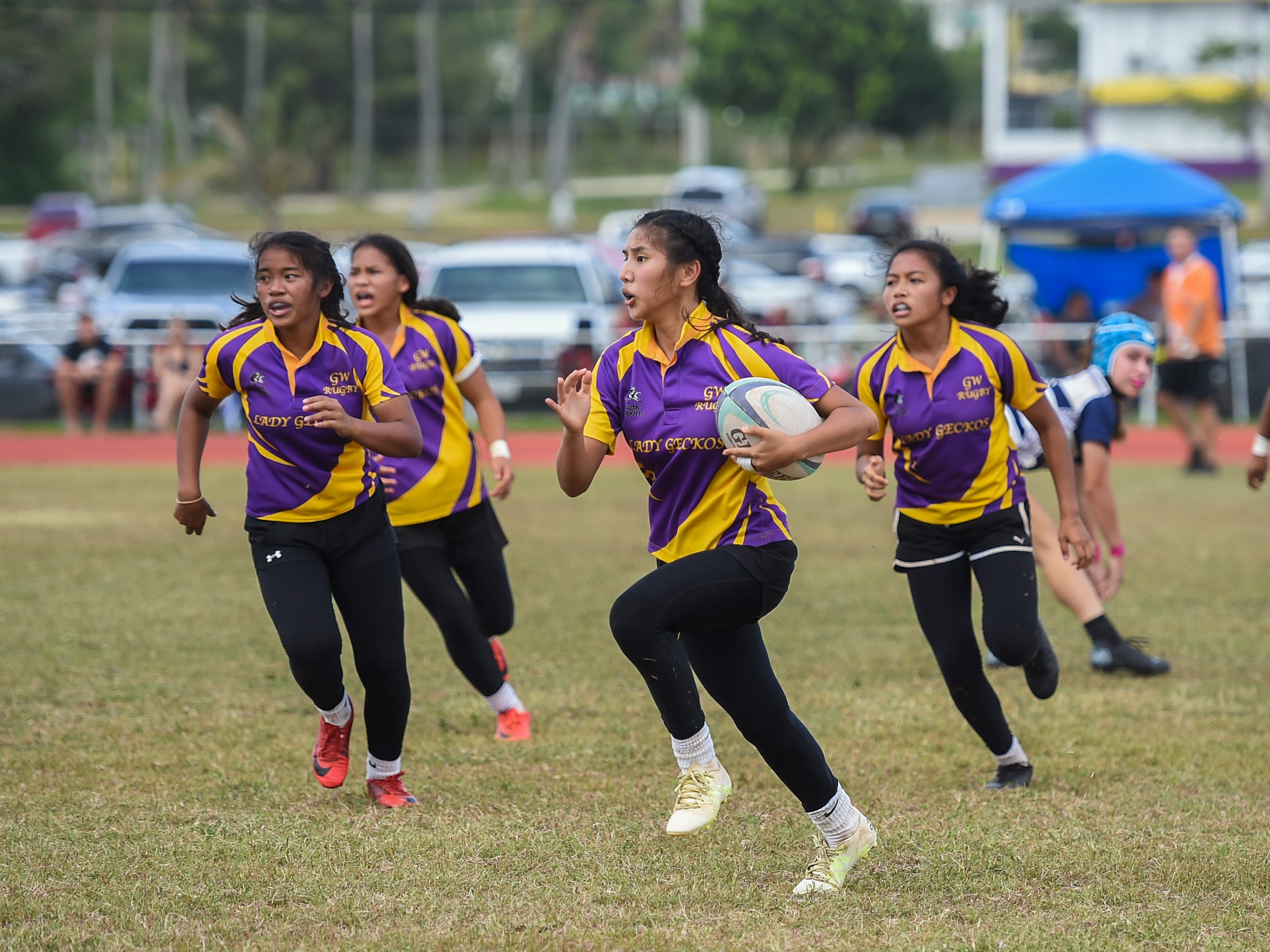 George Washington player Sawyer Park runs the ball against the Notre Dame Royals during their GRFU/IIAAG Girls Rugby Finals game at the GW High School Field in Mangilao, March 16, 2019. Park had scored tries in a 21-17 loss to the Royals for the rugby title.