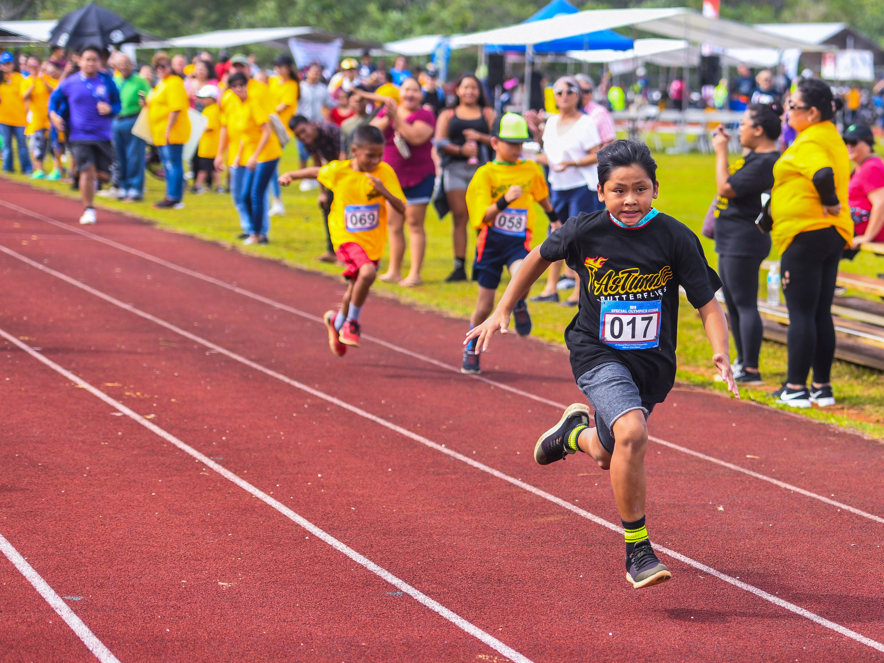 Astumbo Elementary School student Xavior Cruz (017) sprints ahead of other Special Olympians during a 50-meter race at the 43rd Special Olympics Guam Track & Field competition at Okkodo High School in Dededo on Saturday, March 16, 2019.