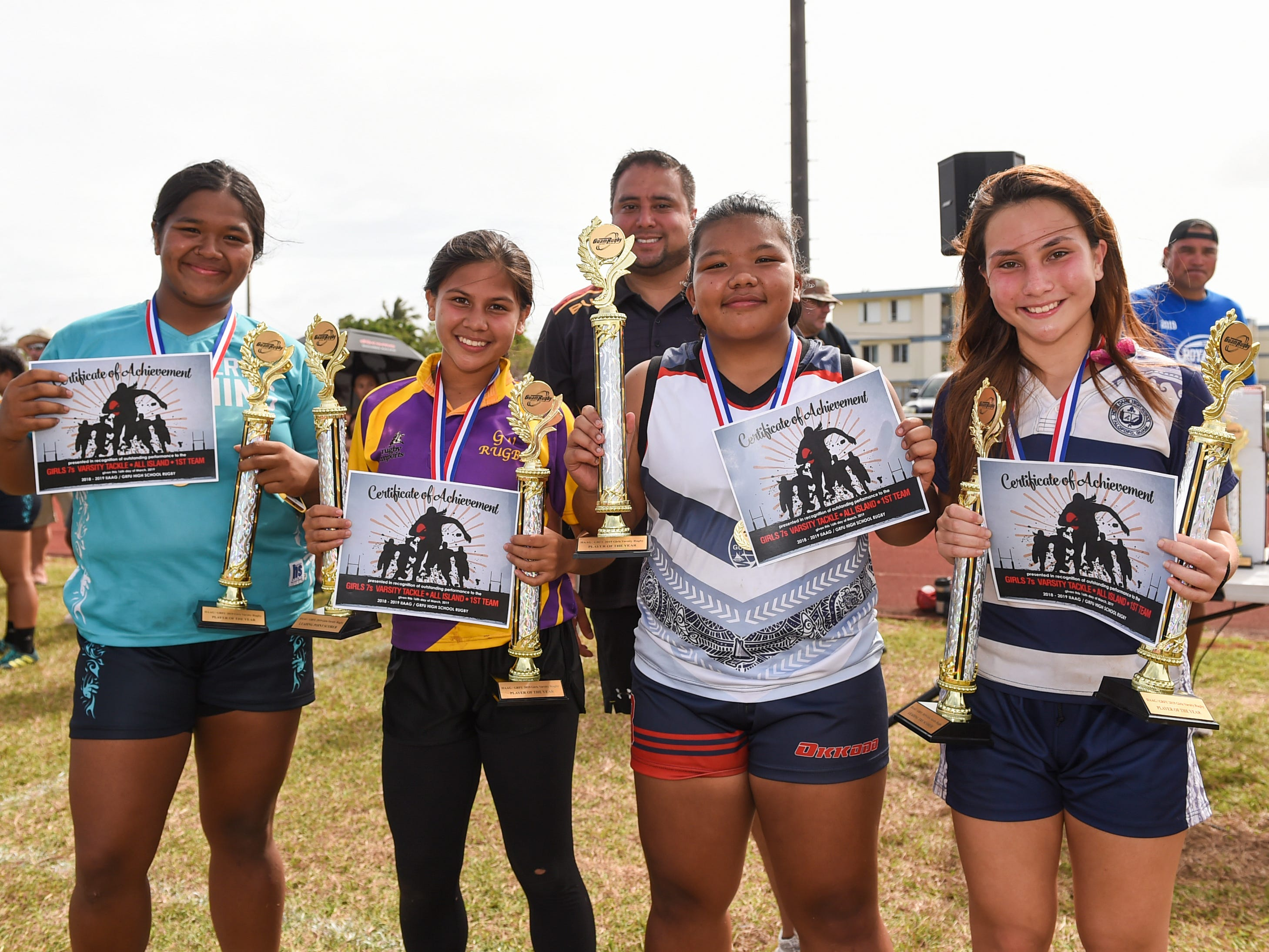 Co-Player of Year Award recipients for the 2018-2019 IIAAG/GRFU Girls Rugby season at the George Washington High School Field, March 16, 2019. From left: Bre'Ani San Nicolas, Southern High School, Aveah Garrido, George Washington High School, Amber Apatang, Okkodo High School, and Faith Moylan, Notre Dame High School.
