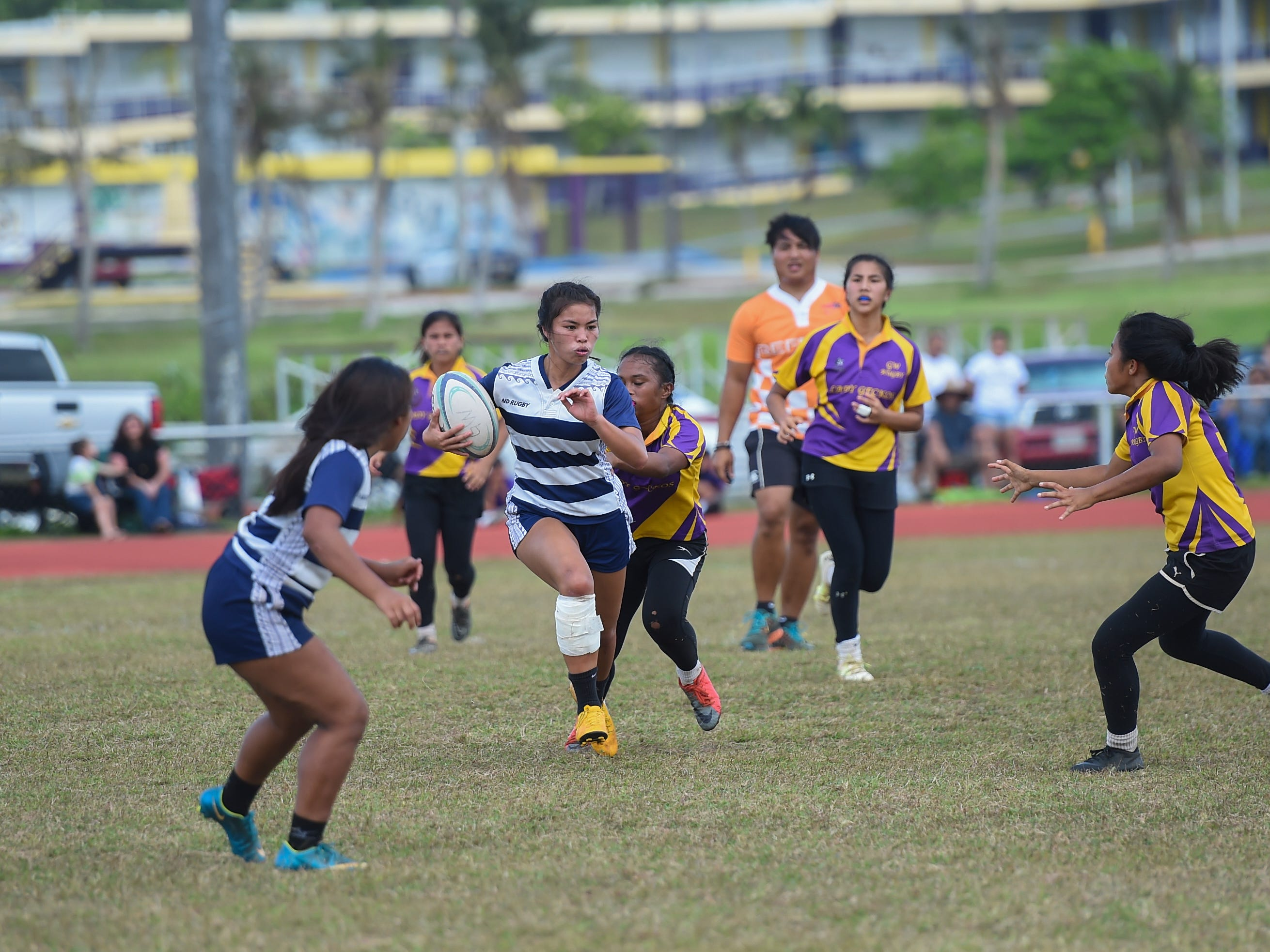 Notre Dame's Taylor Paige Aguon carries the ball against the George Washington Geckos during their GRFU/IIAAG Girls Rugby Finals game at the GW High School Field in Mangilao, March 16, 2019. The Royals went on to beat the Geckos 21-17 for the rugby title.