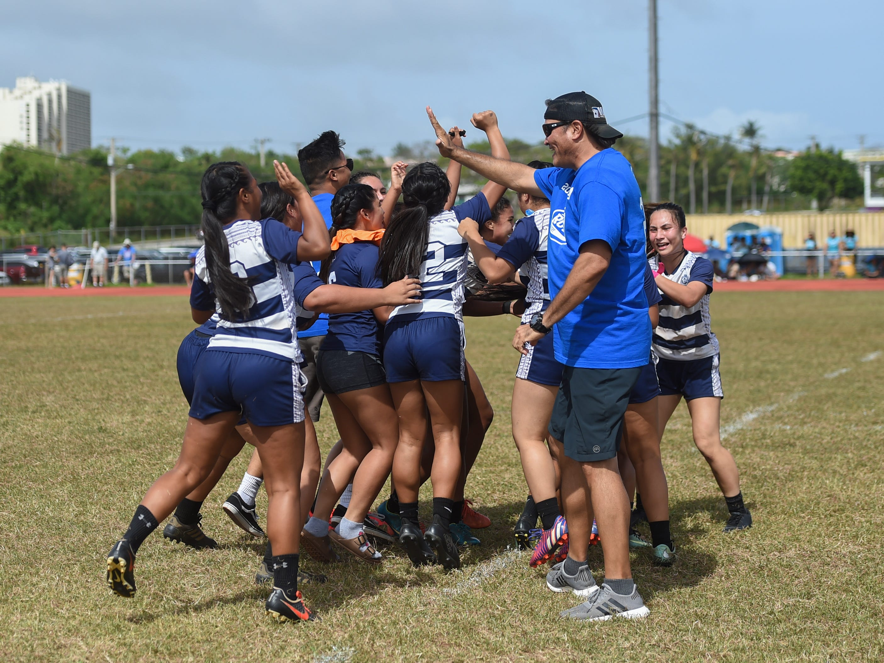 The Notre Dame Royals celebrate their 21-17 win in the GRFU/IIAAG Girls Rugby Finals against the George Washington Geckos at the GW High School Field in Mangilao, March 16, 2019.