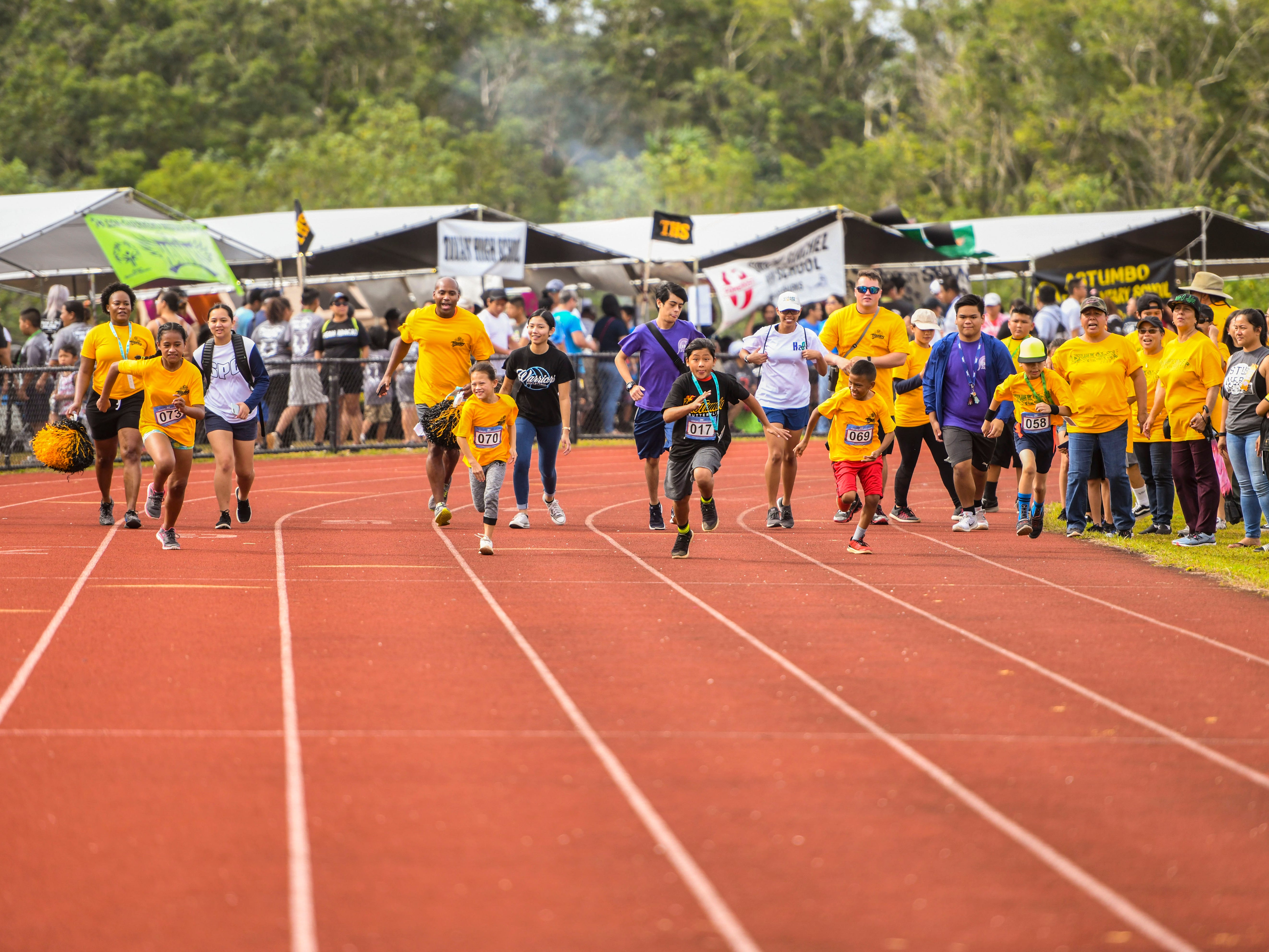 Special Olympians kick off from the starting line during a 50-meter race at the 43rd Special Olympics Guam Track & Field competition at Okkodo High School in Dededo on Saturday, March 16, 2019.