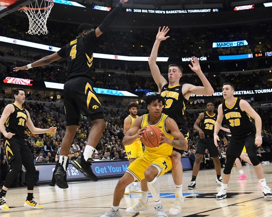 "Iowa players were caught either flat-footed or over-pursuing in a 74-53 loss to Michigan. ""Biggest difference was they ran a lot more ball screen, and we didn't defend it the right way,"" Ryan Kriener, left, said."