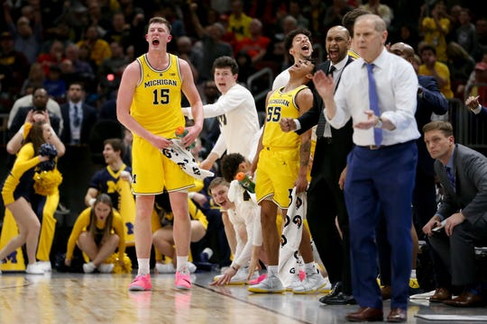 CHICAGO, ILLINOIS - MARCH 15: The Michigan Wolverines bench reacts in the first half against the Iowa Hawkeyes during the quarterfinals of the Big Ten Basketball Tournament at the United Center on March 15, 2019 in Chicago, Illinois. (Photo by Dylan Buell / Getty Images)