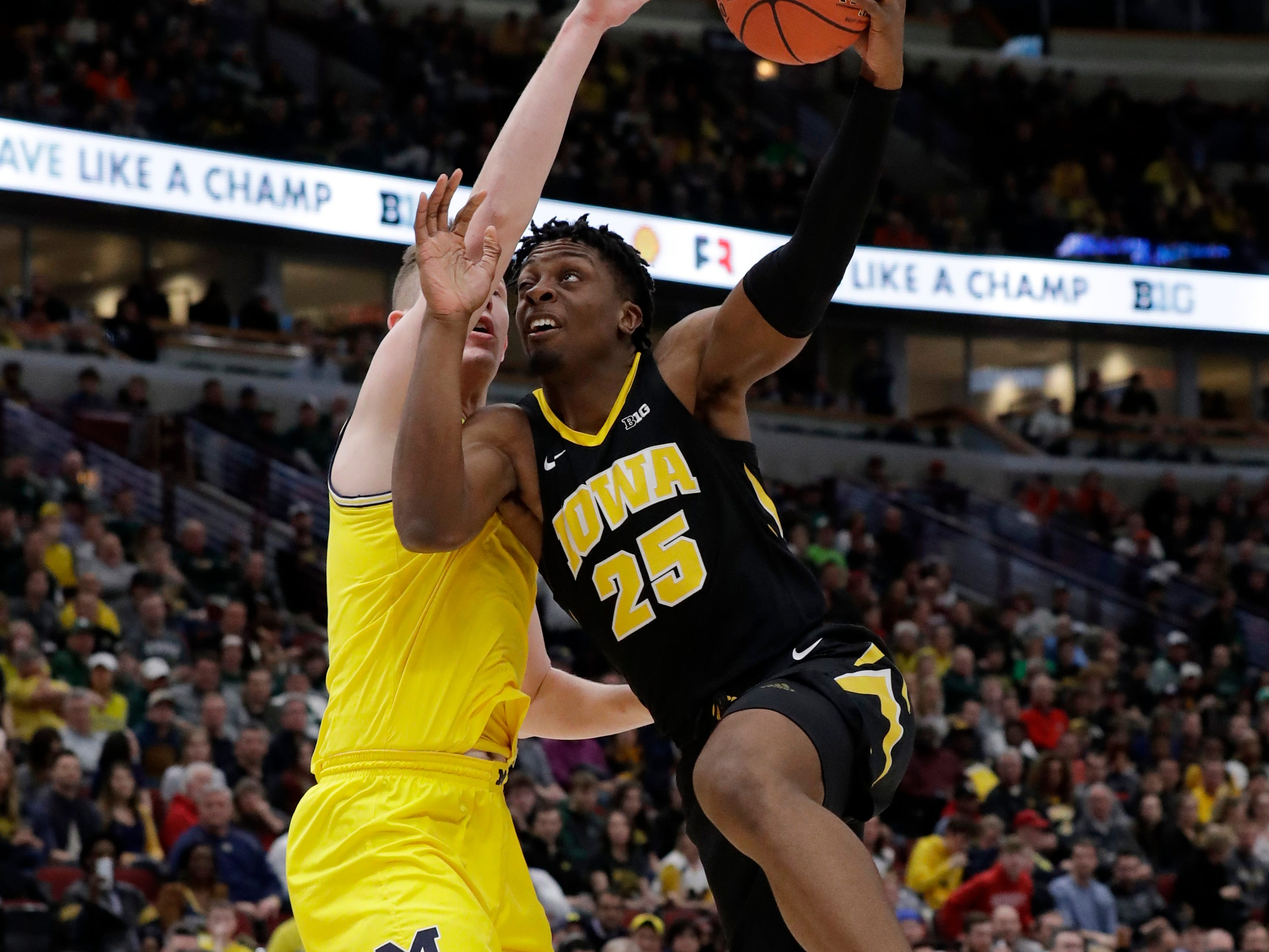 Iowa's Tyler Cook (25) goes up for a basket against Michigan's Jon Teske during the first half of an NCAA college basketball game in the quarterfinals of the Big Ten Conference tournament, Friday, March 15, 2019, in Chicago. (AP Photo/Nam Y. Huh)