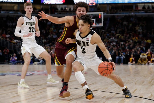 Purdue's Carsen Edwards (3) drives past Minnesota's Gabe Kalscheur (22) during the second half of an NCAA college basketball game in the quarterfinals of the Big Ten Conference tournament, Friday, March 15, 2019, in Chicago. (AP Photo/Nam Y. Huh)