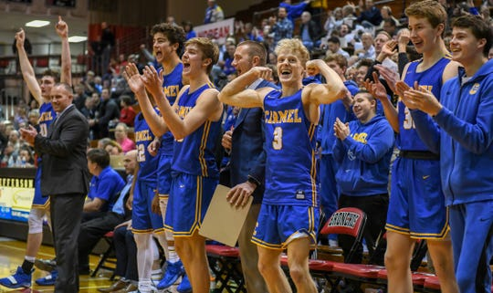 Carmel's Karsten Windlan, 3, leads the celebration as time runs out in their 71-42 4A semi-state win over Penn High School in Lafayette on Saturday March 16, 2019.