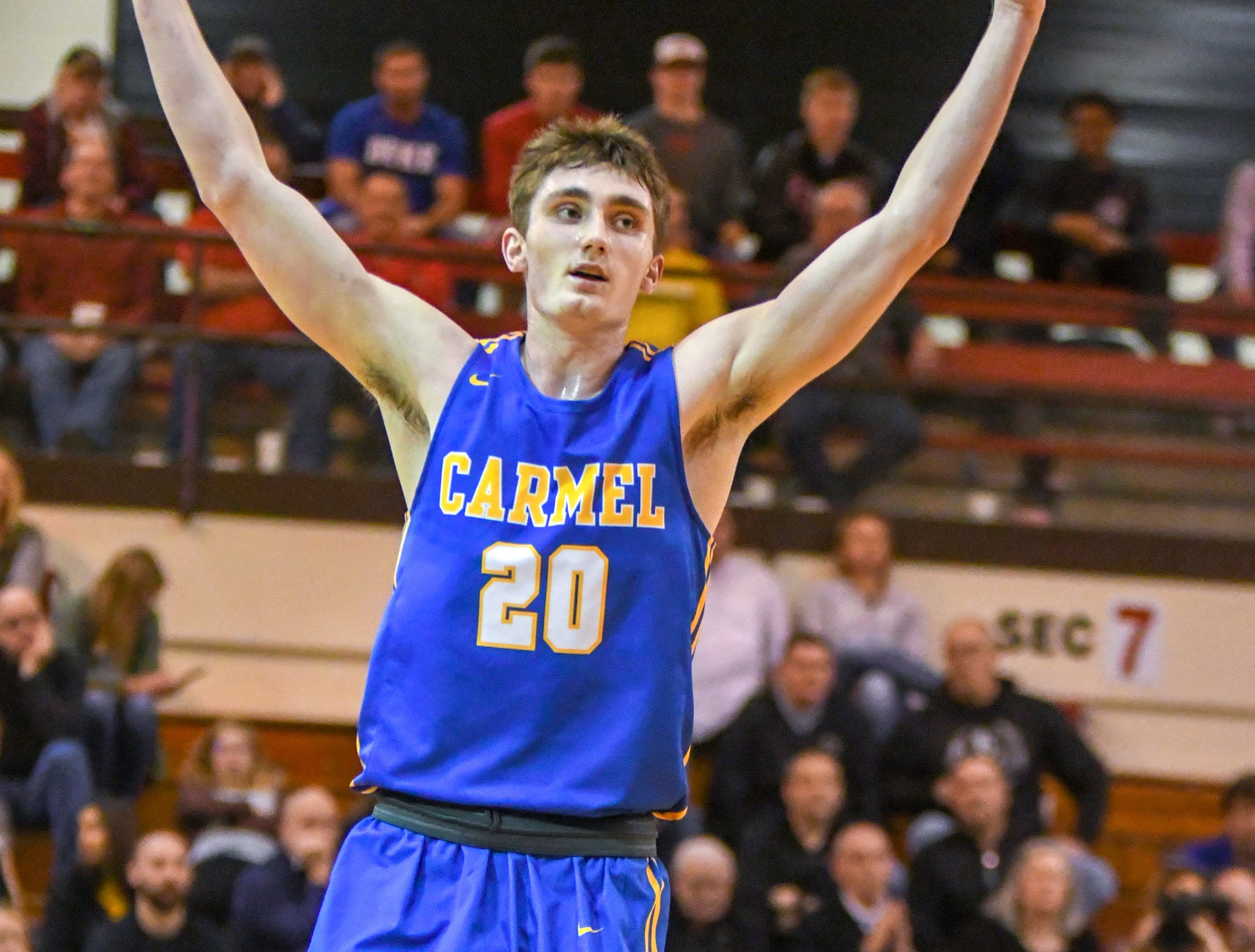 Carmel's Andrew Owens reacts to hitting a three-point shot during his teams 71-42 win over Penn High School in Lafayette on Saturday March 16, 2019. Carmel moves on to the state finals after winning the 4A semi-state today.