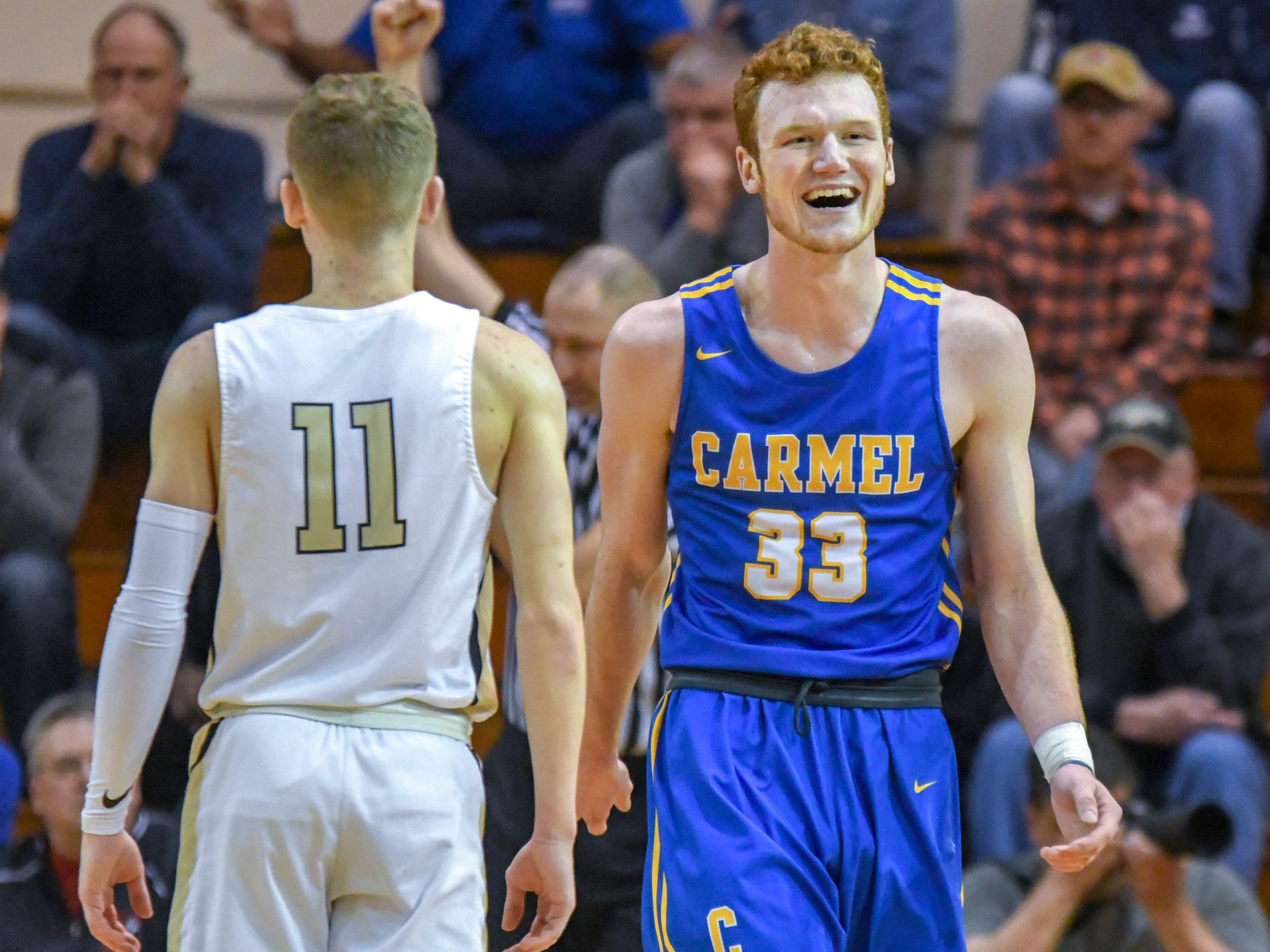 Carmel's John-Michael Mulloy is all smiles during his teams 71-42 win over Penn High School in Lafayette on Saturday March 16, 2019. Carmel moves on to the state finals after winning the 4A semi-state today.