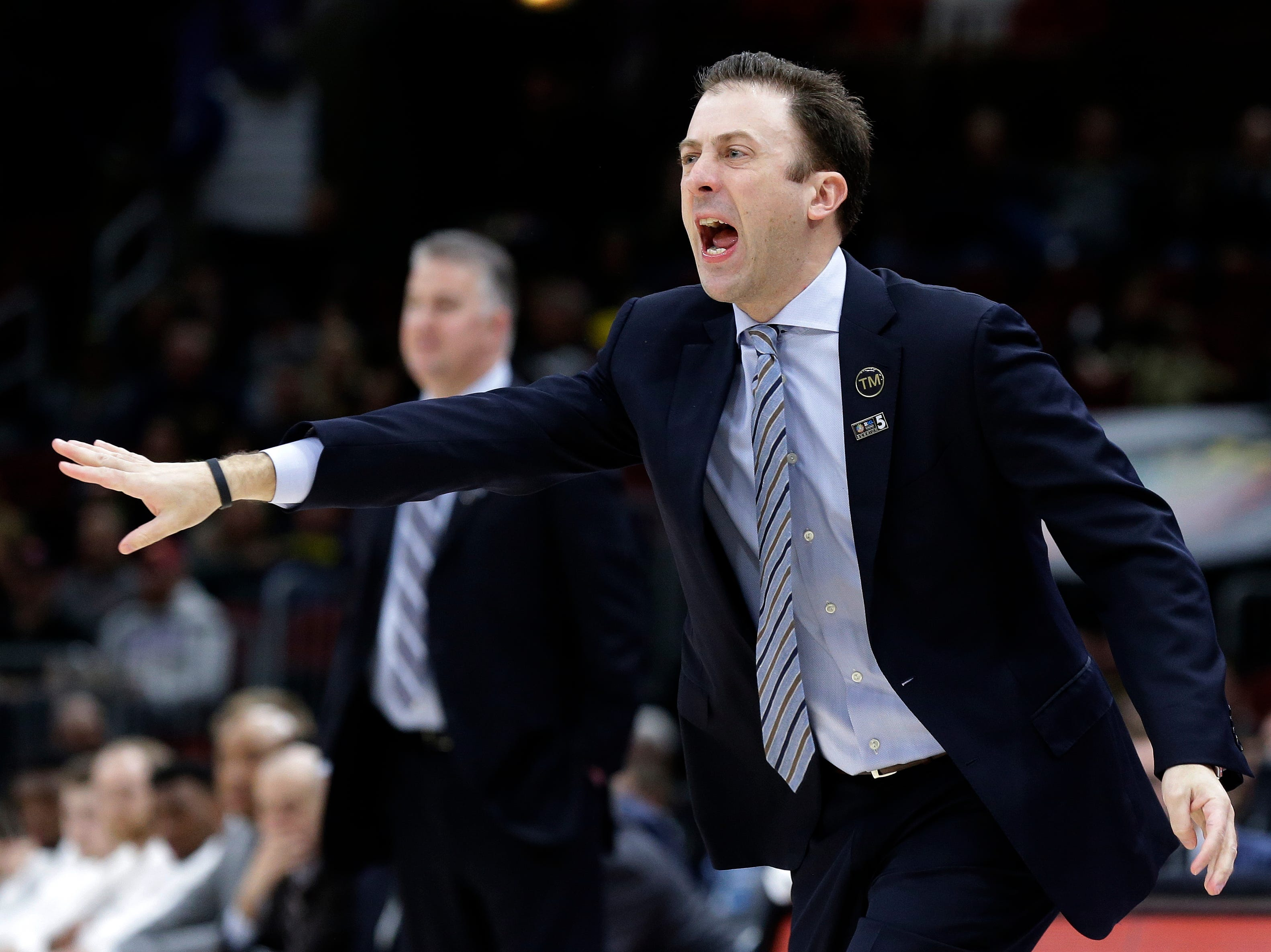 Minnesota head coach Richard Pitino directs his team during the first half of an NCAA college basketball game against Purdue in the quarterfinals of the Big Ten Conference tournament, Friday, March 15, 2019, in Chicago. (AP Photo/Kiichiro Sato)
