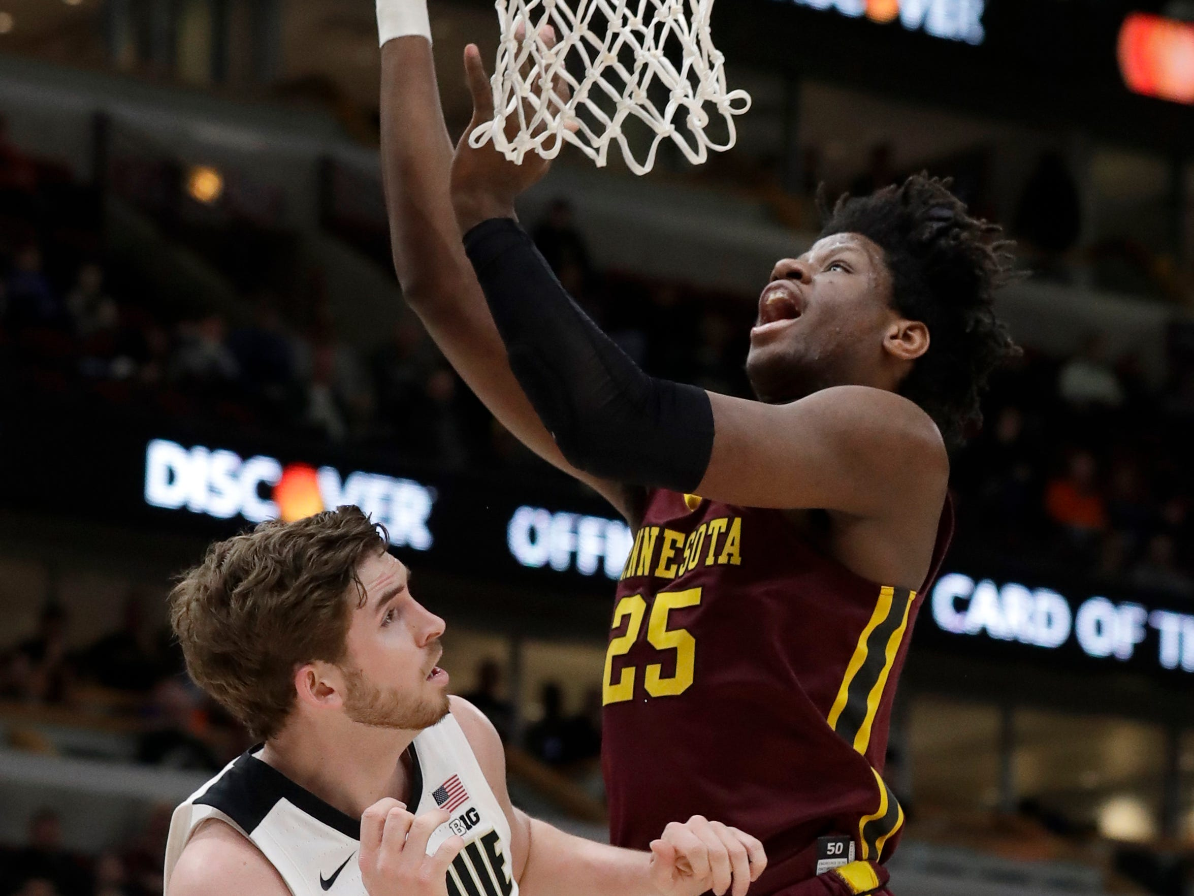 Minnesota's Daniel Oturu (25) goes up for a shot against Purdue's Ryan Cline (14) during the first half of an NCAA college basketball game in the quarterfinals of the Big Ten Conference tournament, Friday, March 15, 2019, in Chicago. (AP Photo/Nam Y. Huh)