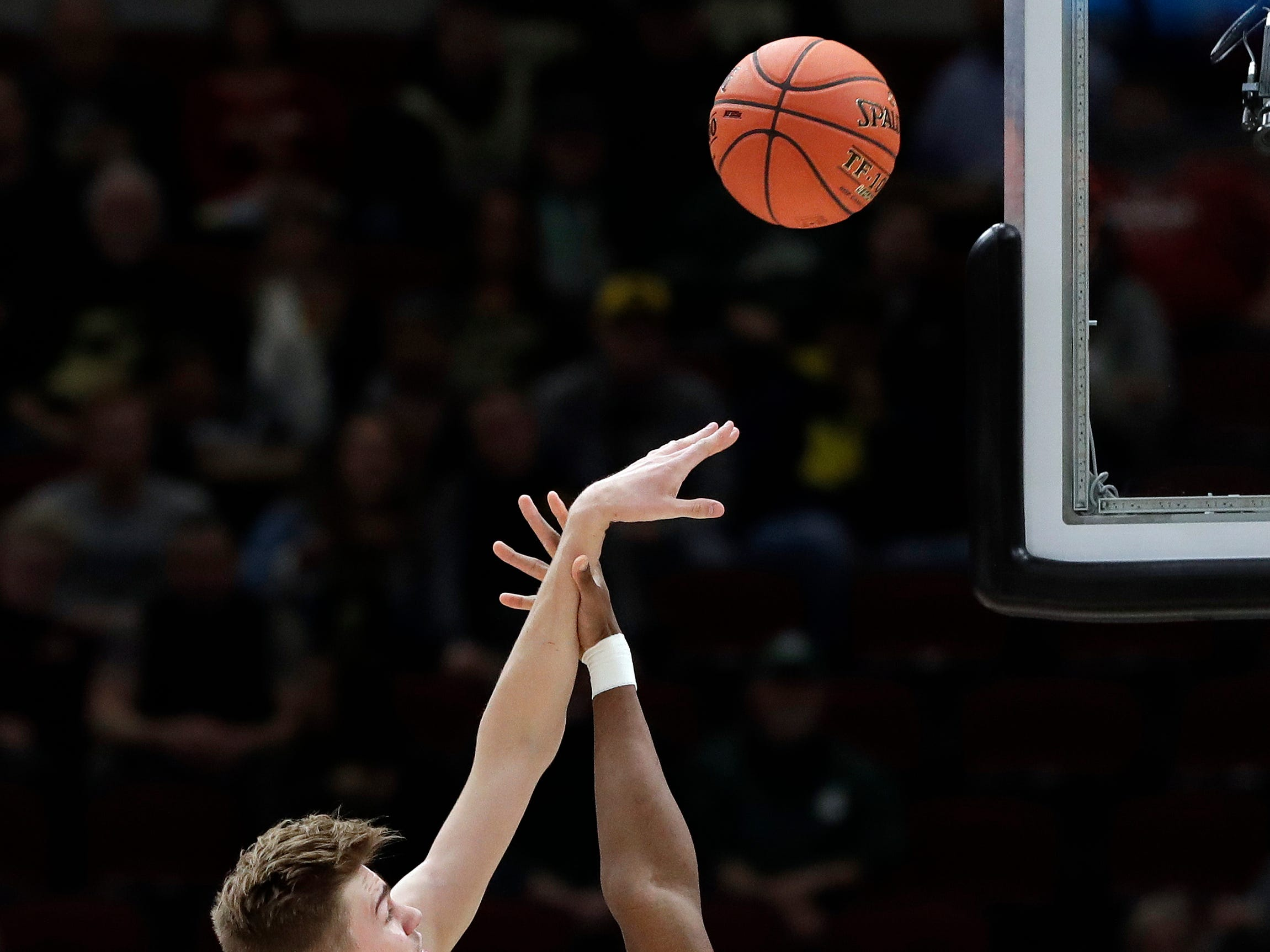 Purdue's Matt Haarms (32) shoots over Minnesota's Daniel Oturu (25) during the first half of an NCAA college basketball game in the quarterfinals of the Big Ten men's tournament, Friday, March 15, 2019, in Chicago. (AP Photo/Nam Y. Huh)
