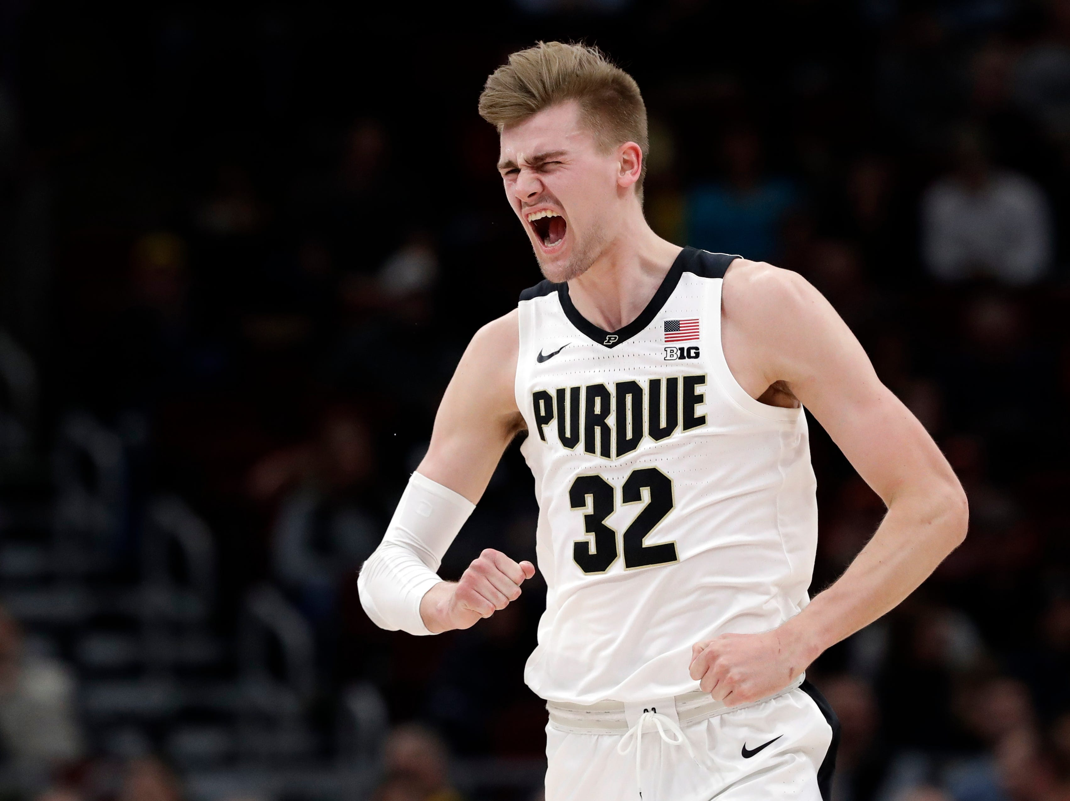 Purdue's Matt Haarms reacts after scoring a basket during the first half of the team's NCAA college basketball game against Minnesota in the quarterfinals of the Big Ten men's tournament Friday, March 15, 2019, in Chicago. (AP Photo/Nam Y. Huh)