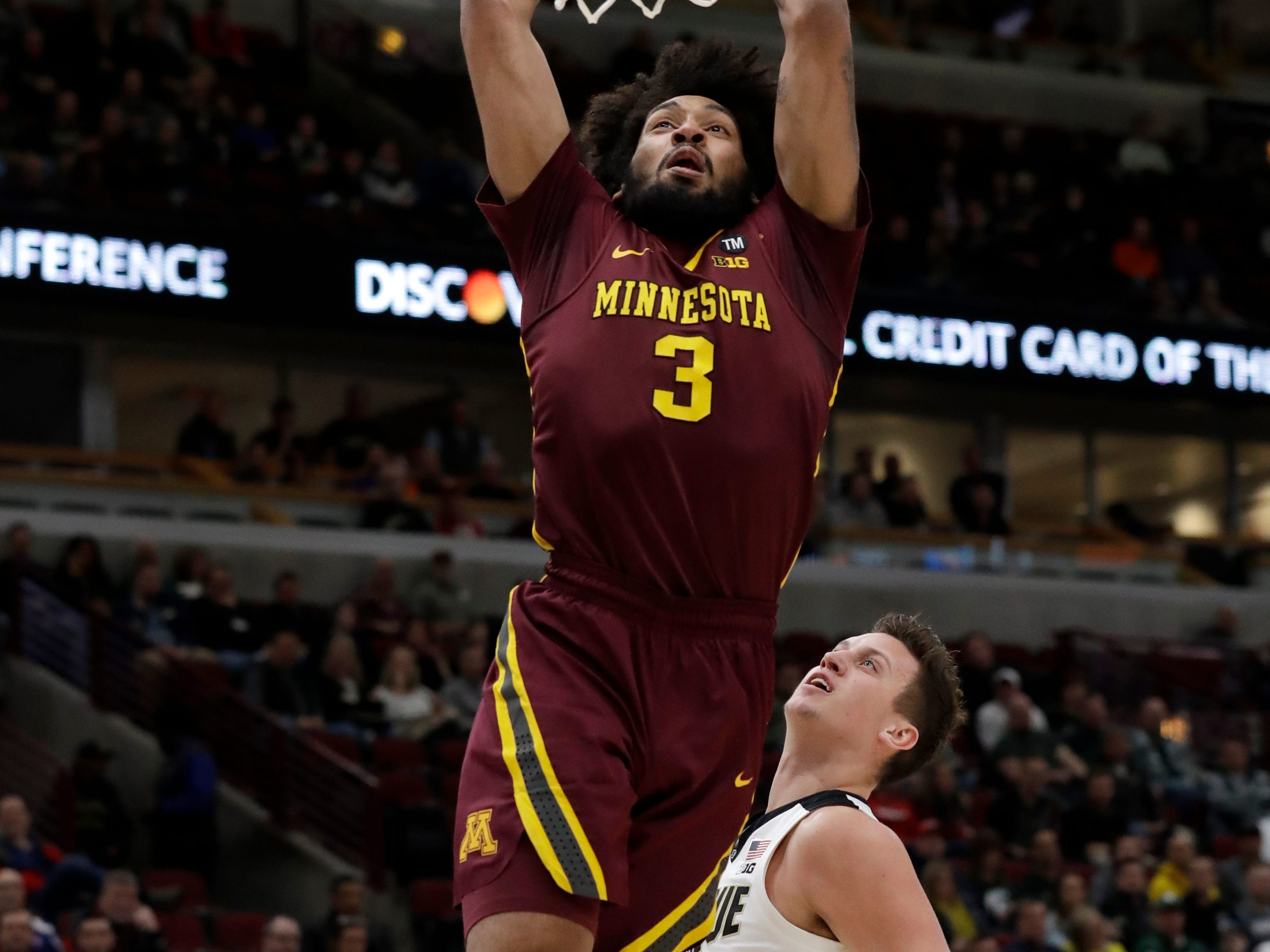 Minnesota's Jordan Murphy (3) goes up for a dunk against Purdue's Grady Eifert (24) during the first half of an NCAA college basketball game in the quarterfinals of the Big Ten Conference tournament, Friday, March 15, 2019, in Chicago. (AP Photo/Nam Y. Huh)
