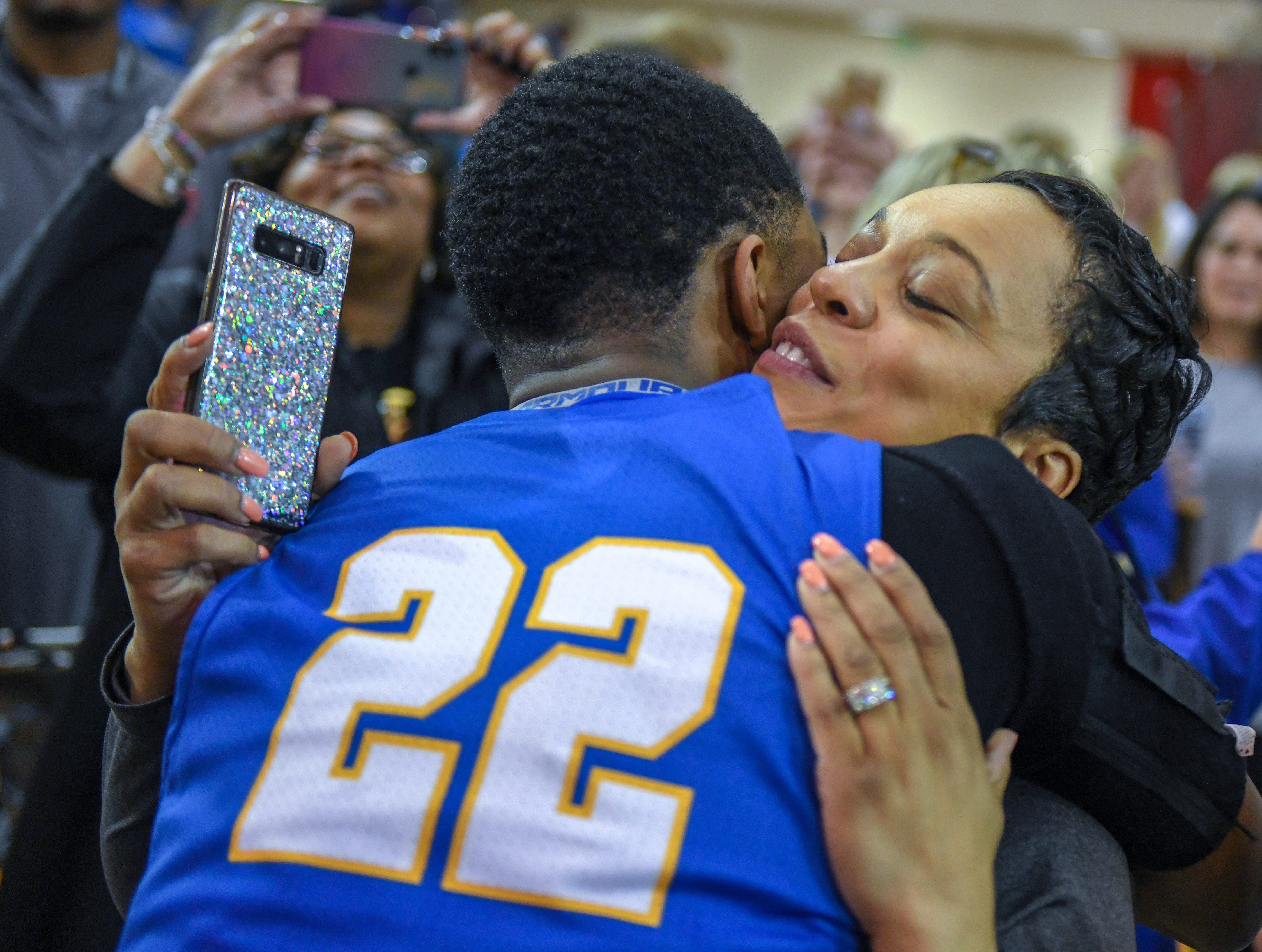 Carmel's Robert Fry is congratulated by his mother Katina Smith after a 71-42 win over Penn High School in Lafayette on Saturday March 16, 2019. Carmel moves on to the state finals after winning the 4A semi-state today.