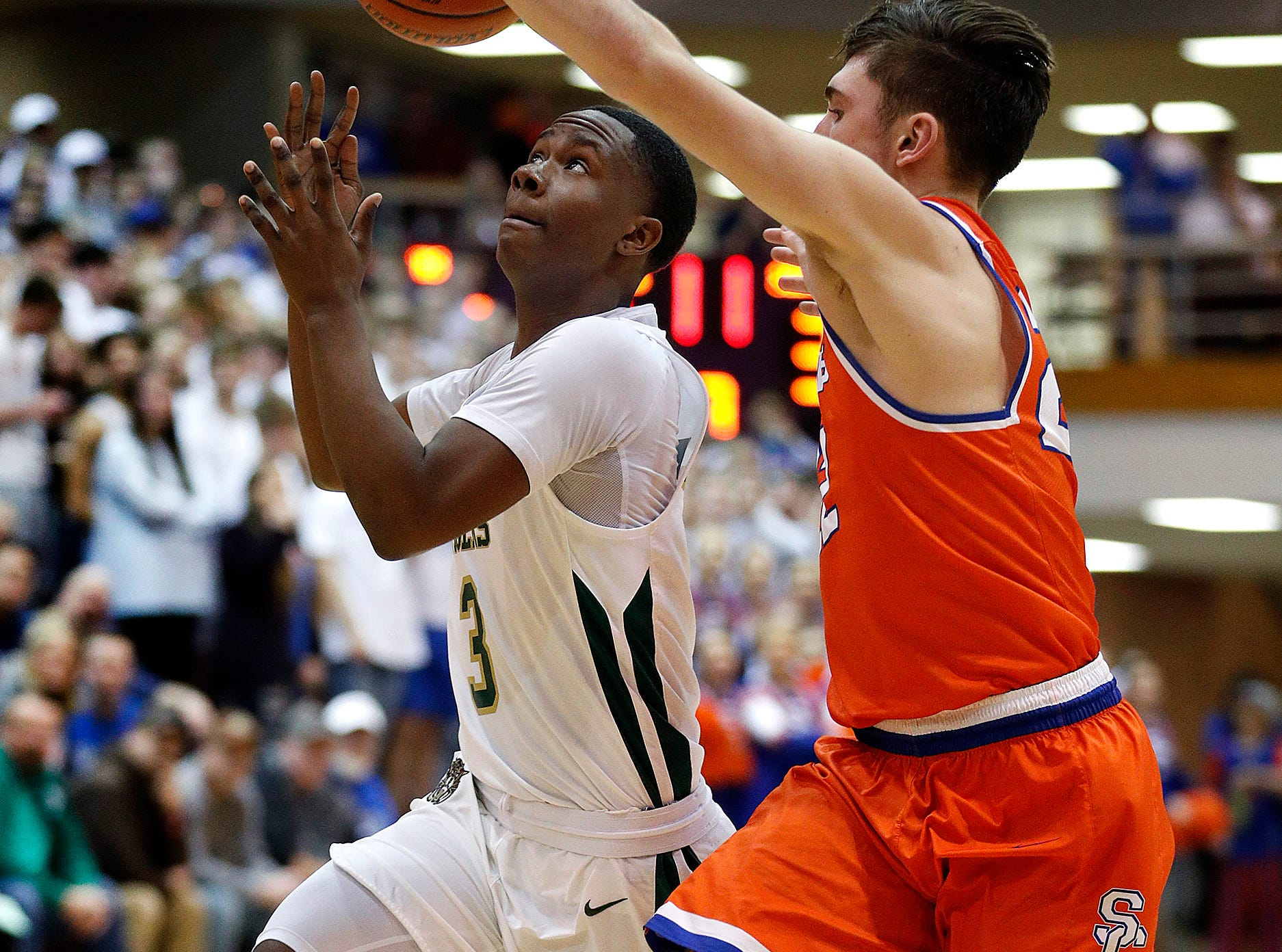 Crispus Attucks Tigers SinCere McMahon (3) looses control of the ball as he drives on Silver Creek Dragons Ty Kessinger (22) in the second half of their IHSAA boys' Semi-State basketball game at Seymour High School gym in Seymour IN, on Saturday, Mar. 16, 2019. The Silver Creek Dragons defeated the Crispus Attucks Tigers 72-69.