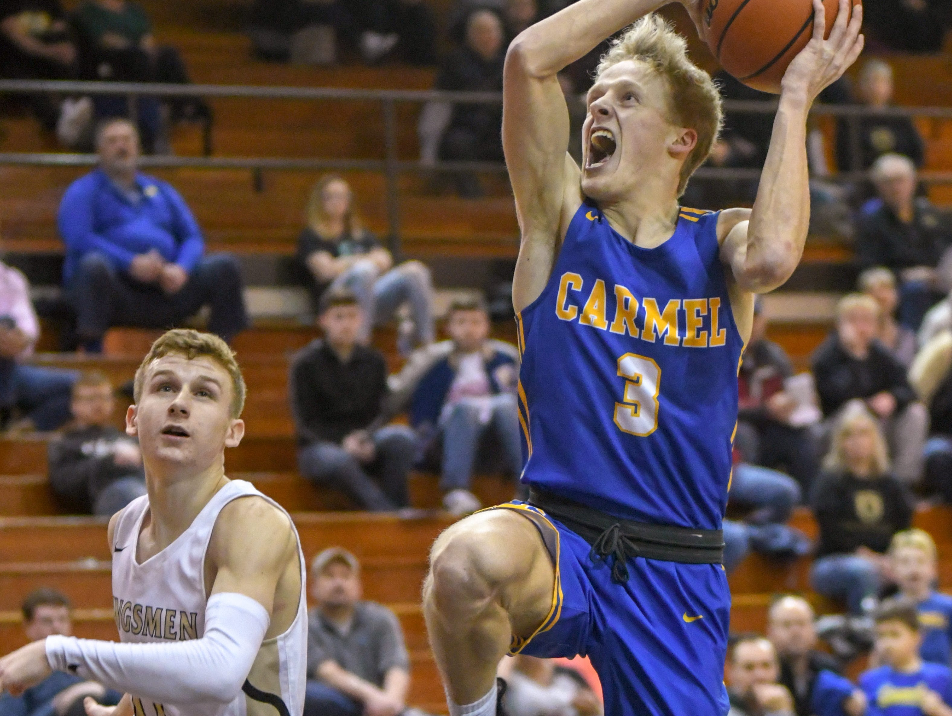 Carmel's Karsten Windlan drives the lane for a basket in the Greyhounds 71-42 win over Penn High School in Lafayette on Saturday March 16, 2019. Carmel moves on to the state finals after winning the 4A semi-state today.