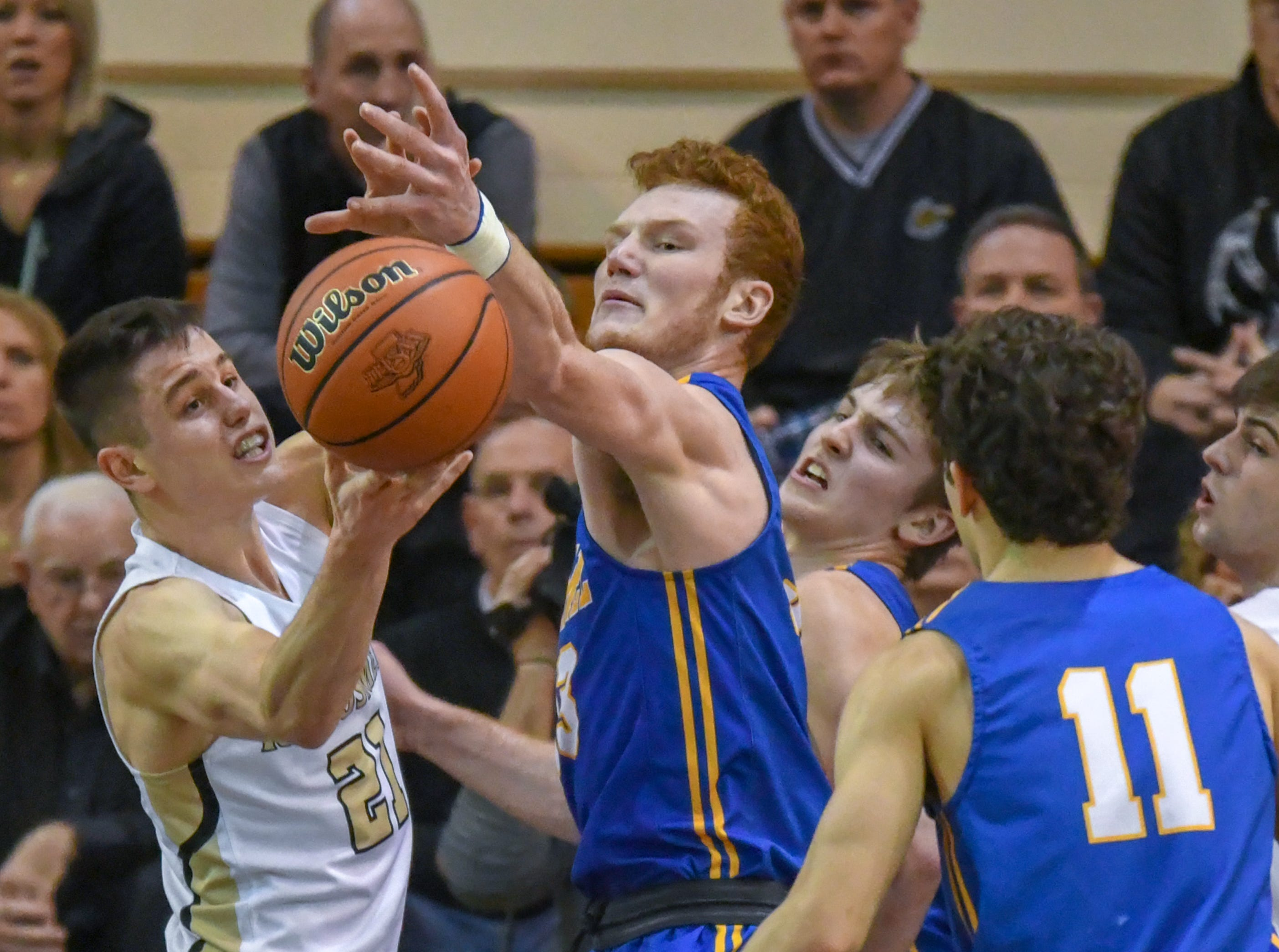 Carmel's John-Michael Mulloy battles for the ball during his teams 71-42 win over Penn High School in Lafayette on Saturday March 16, 2019. Carmel moves on to the state finals after winning the 4A semi-state today.