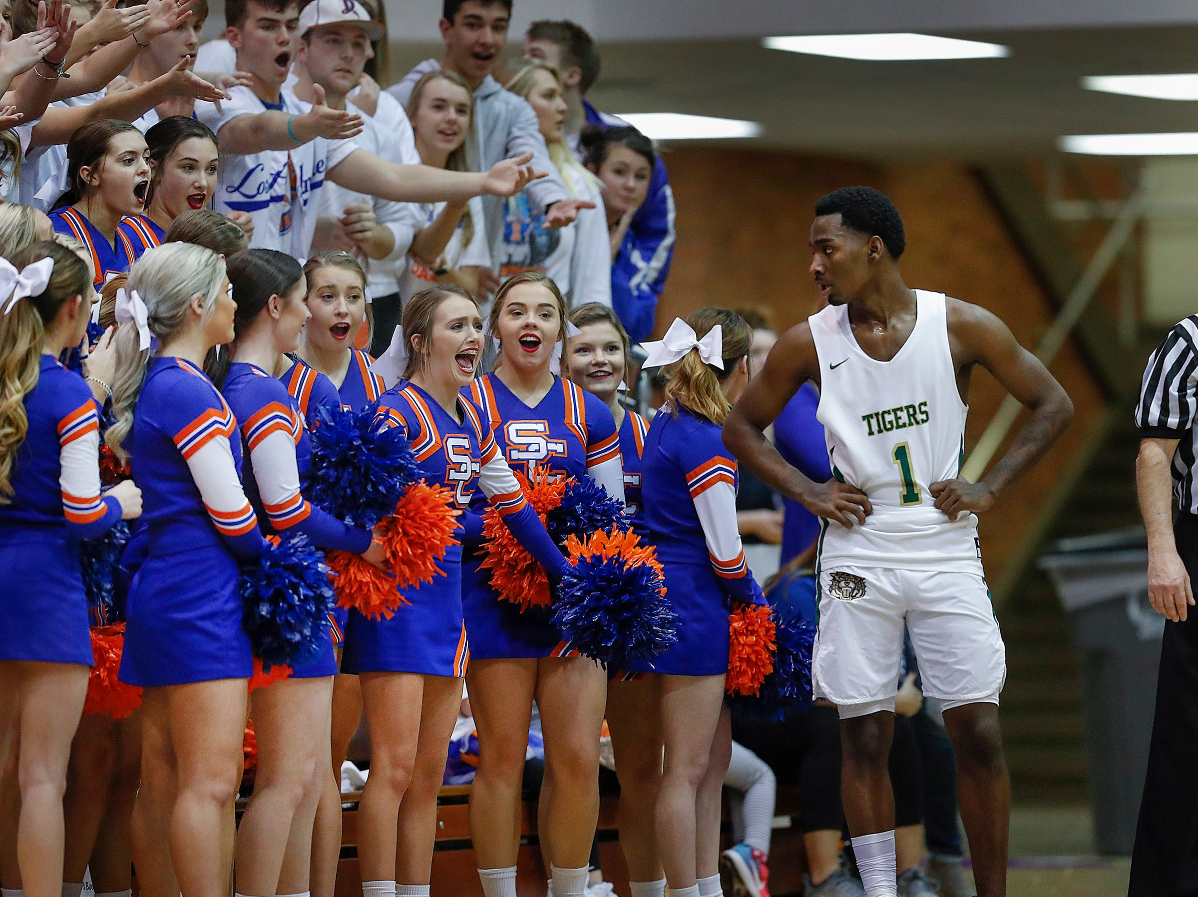 Crispus Attucks Tigers Harold Bennett (1) gets an earful of comments from the Silver Creek Dragons student fan section in the second half of their IHSAA boys' Semi-State basketball game at Seymour High School gym in Seymour IN, on Saturday, Mar. 16, 2019. The Silver Creek Dragons defeated the Crispus Attucks Tigers 72-69.