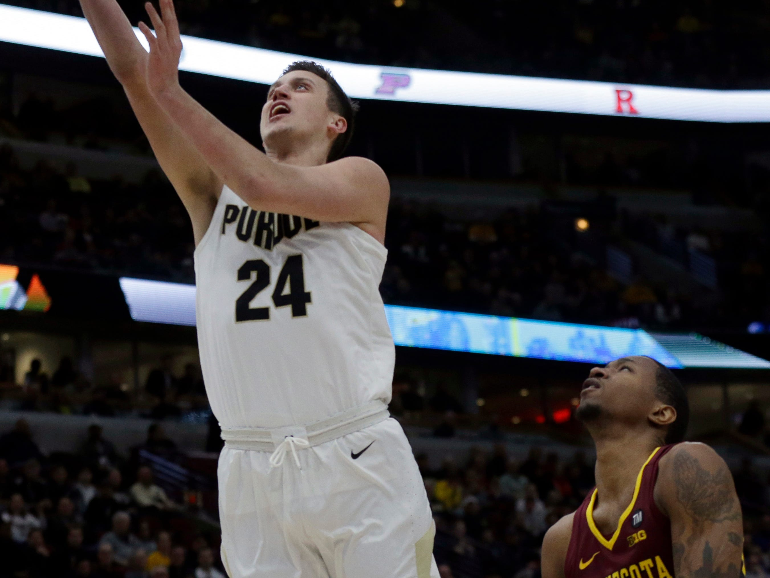 Purdue's Grady Eifert (24) goes up for a lay up against Minnesota's Dupree McBrayer (1) during the first half of an NCAA college basketball game in the quarterfinals of the Big Ten Conference tournament, Friday, March 15, 2019, in Chicago. (AP Photo/Kiichiro Sato)