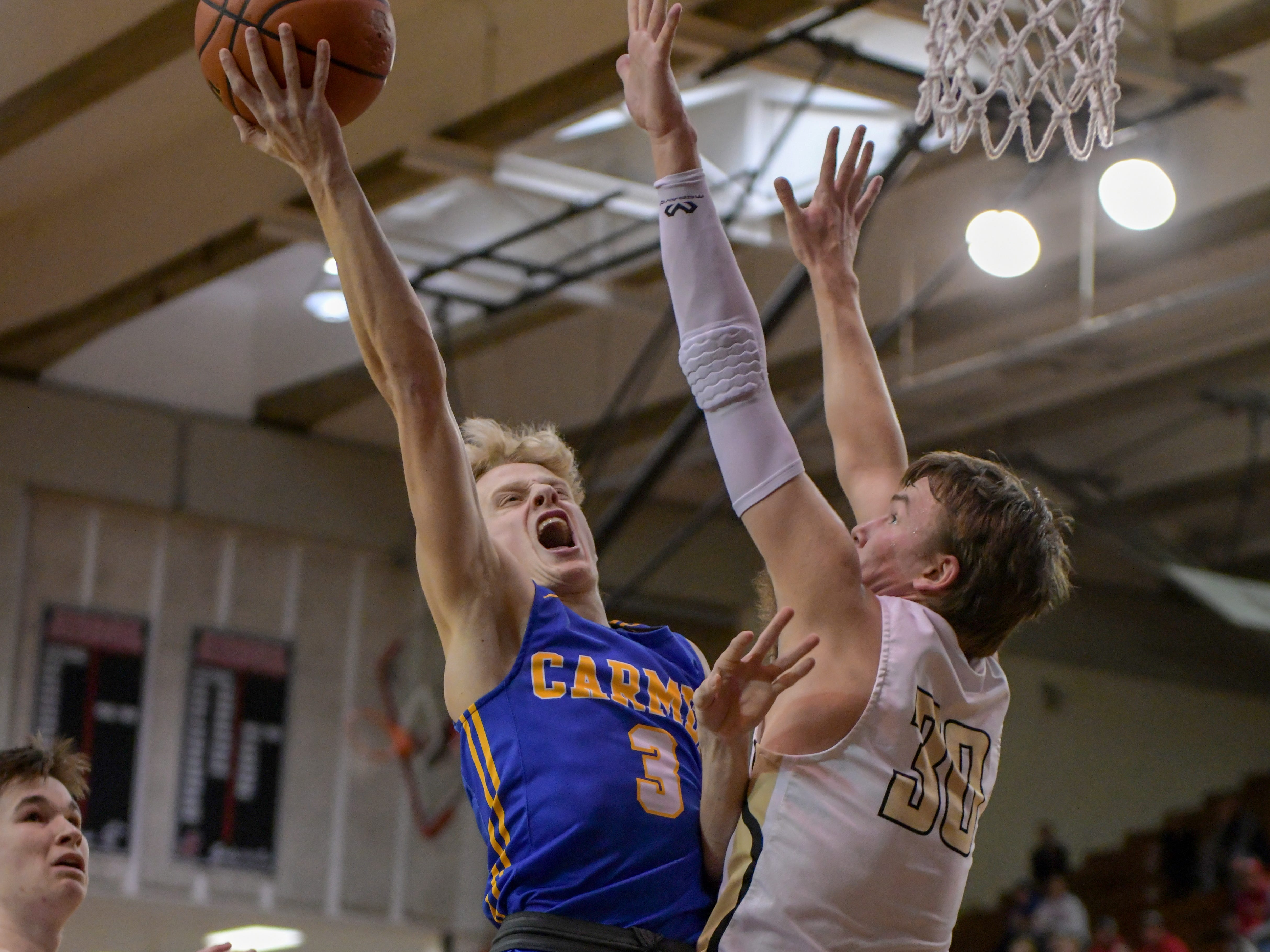 Carmel's Karsten Windlan drives the lane for a basket in the first half against Penn High School in Lafayette on Saturday March 16, 2019. Carmel is battling Penn in the 4A semi-state today.