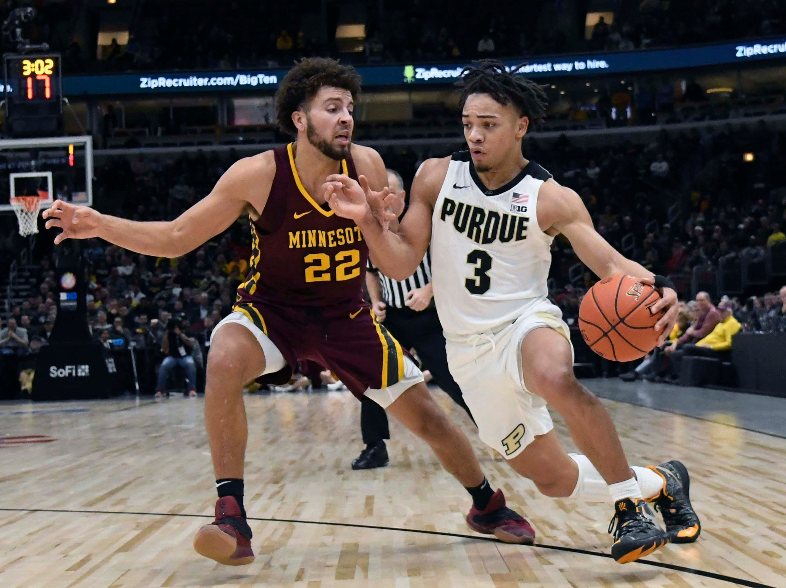 Boilermakers guard Carsen Edwards (3) drives to the basket as Minnesota Golden Gophers guard Gabe Kalscheur (22) defends him during the second half in the Big Ten conference tournament at United Center.