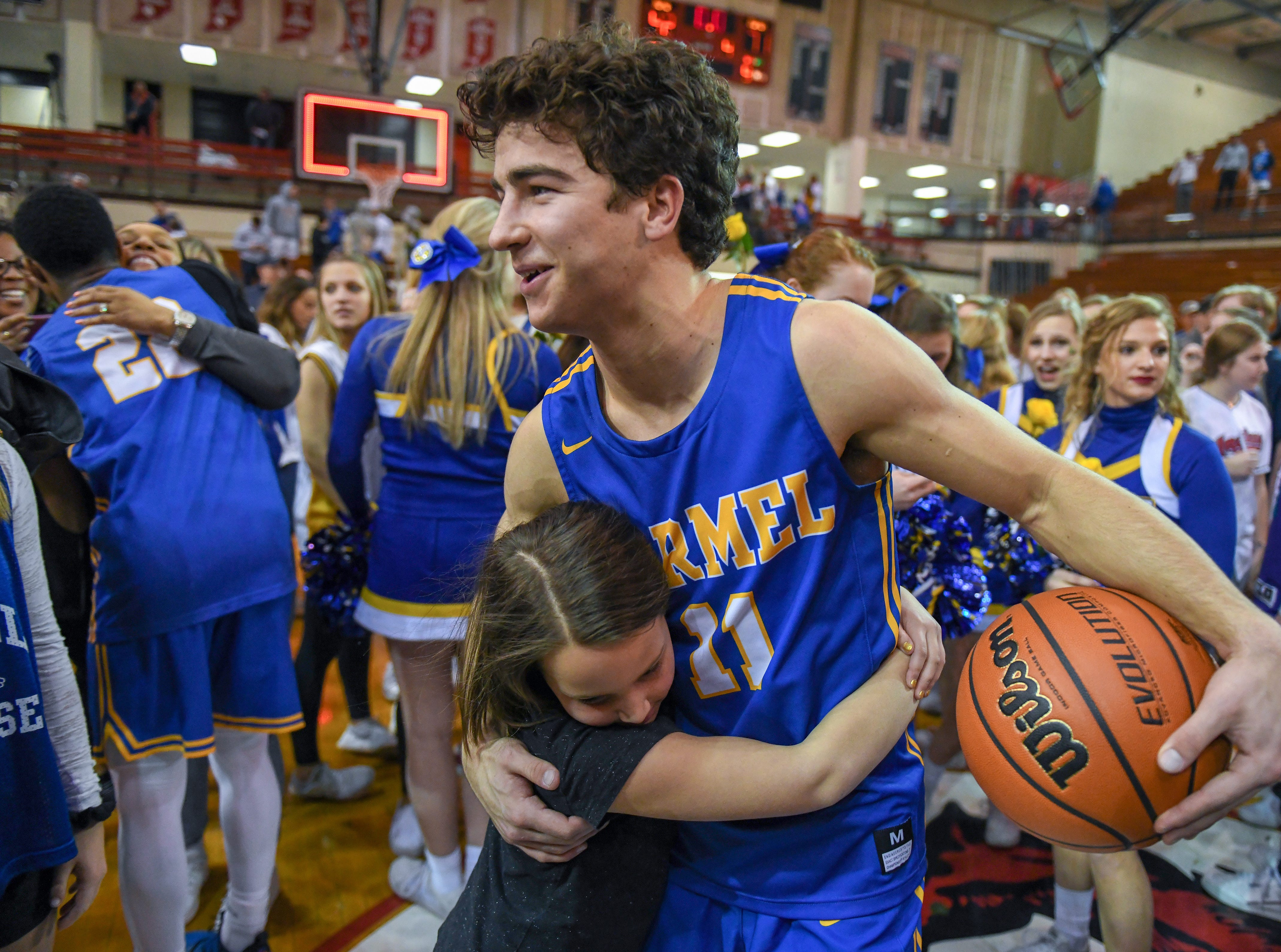 Carmel's Luke Heady gets congratulated after a 71-42 win over Penn High School in Lafayette on Saturday March 16, 2019. Carmel moves on to the state finals after winning the 4A semi-state today.