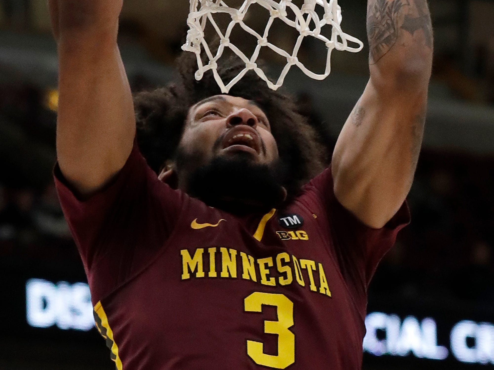 Minnesota's Jordan Murphy dunks during the first half against Purdue in the quarterfinals of the Big Ten Conference tournament, Friday, March 15, 2019, in Chicago.
