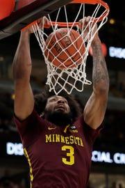 Minnesota's Jordan Murphy dunks against Purdue on Friday.