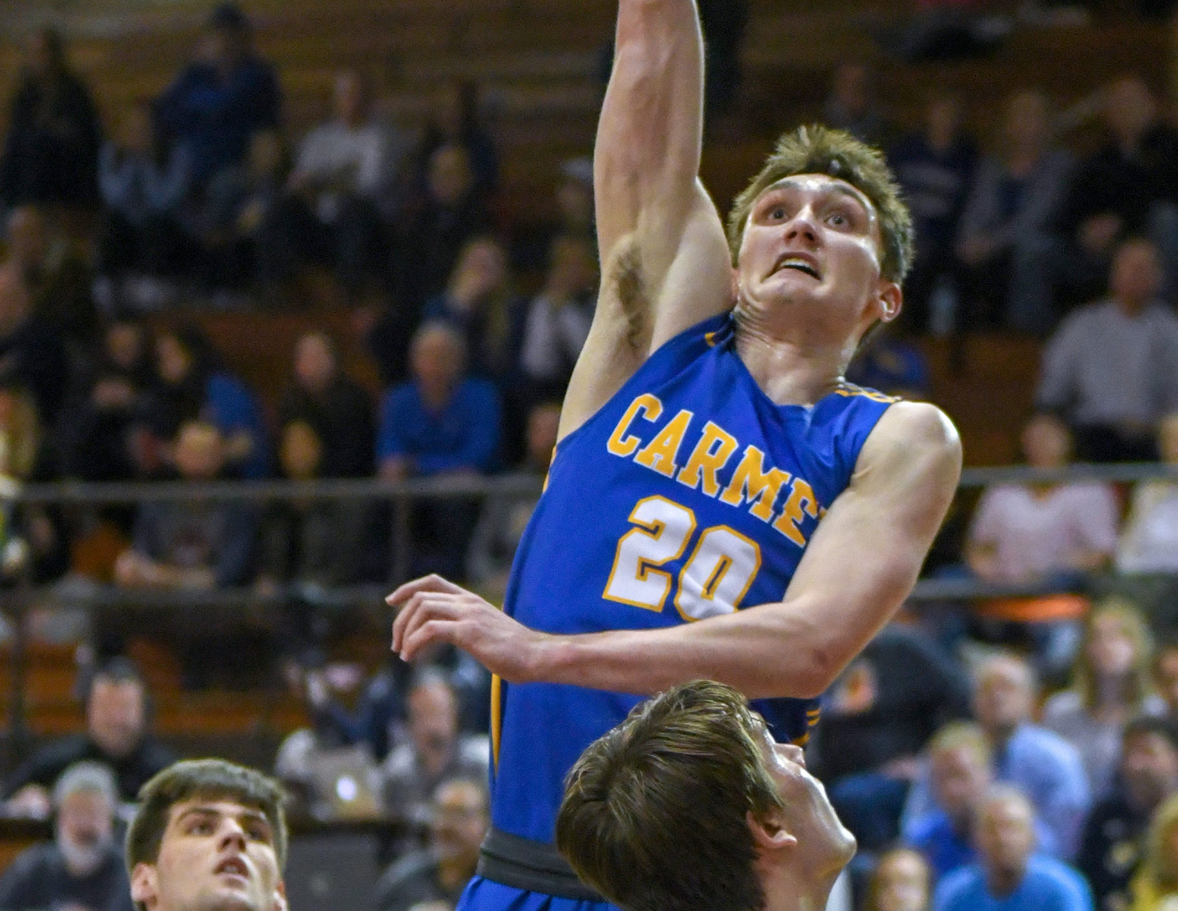 Carmel's Andrew Owens scores during his teams 71-42 win over Penn High School in Lafayette on Saturday March 16, 2019. Carmel moves on to the state finals after winning the 4A semi-state today.