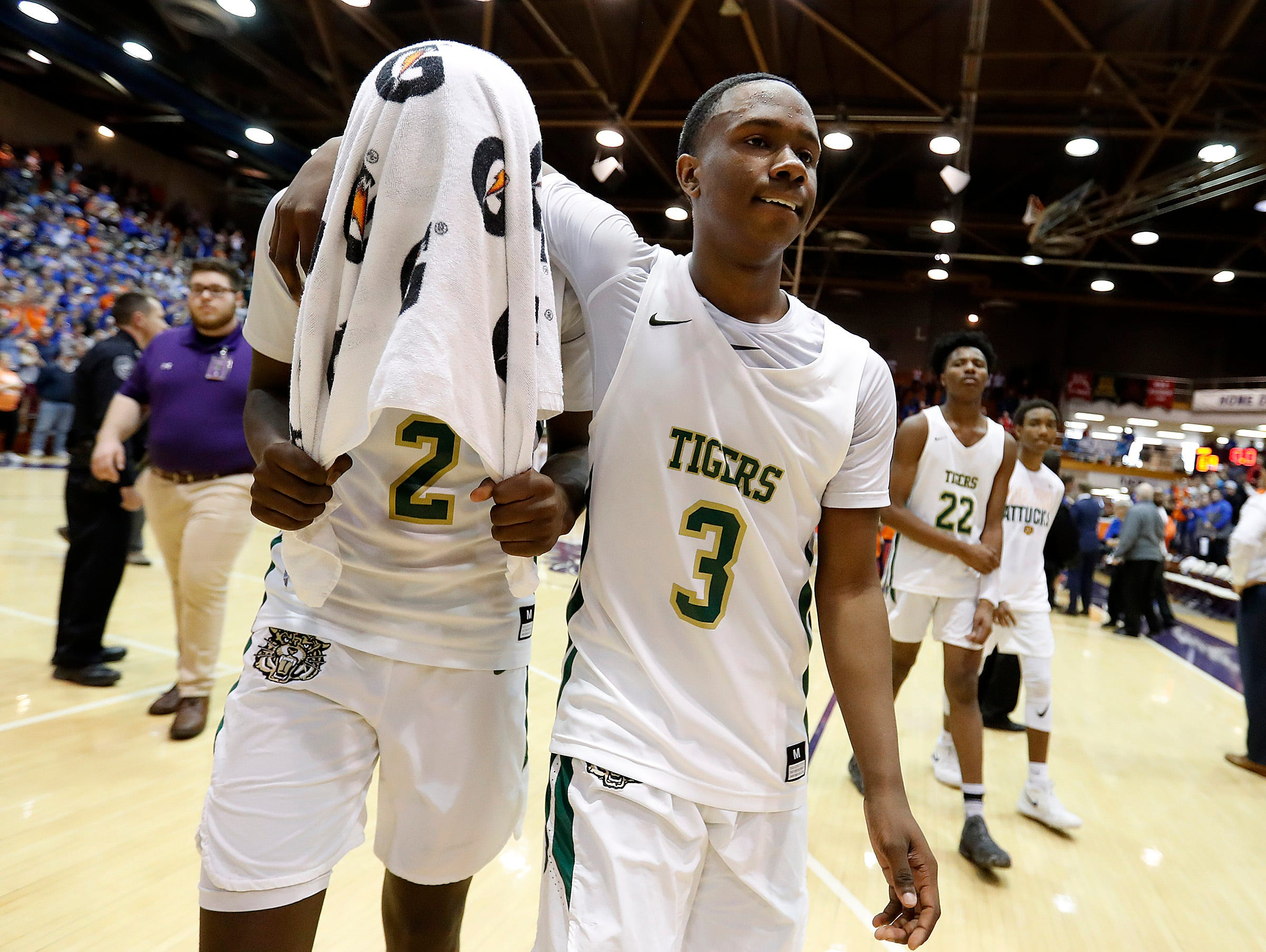 Dejected Crispus Attucks Tigers SinCere McMahon (3) and Donavon Barnett (2) walk off the court following loss to the Silver Creek Dragons in the IHSAA boys' Semi-State basketball game at Seymour High School gym in Seymour IN, on Saturday, Mar. 16, 2019. The Silver Creek Dragons defeated the Crispus Attucks Tigers 72-69.