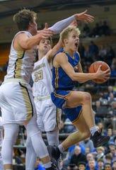 Carmel's Karsten Windlan drives the lane for a basket in the Greyhounds 71-42 win over Penn.