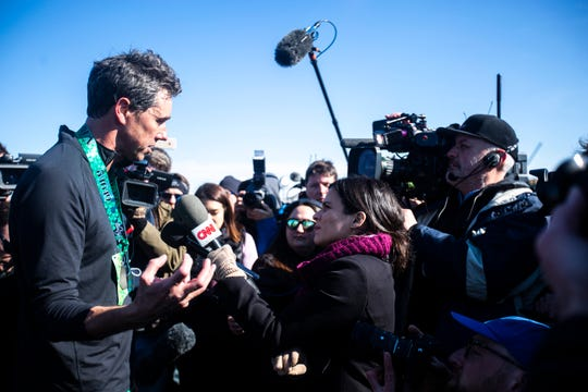 """Democratic presidential candidate Beto O'Rourke speaks with reporters after finishing the """"We Run LUCKY RUN 5K"""" on Saturday, March 16, 2019, outside the University of Iowa Community Credit Union building in North Liberty, Iowa."""