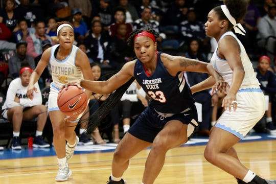Jackson State's Marneshia Hamer (23) drives the lane as a Southern player defends during the SWAC championship Saturday, Marach 16, at Bill Harris Arena in Birmingham, Alabama.