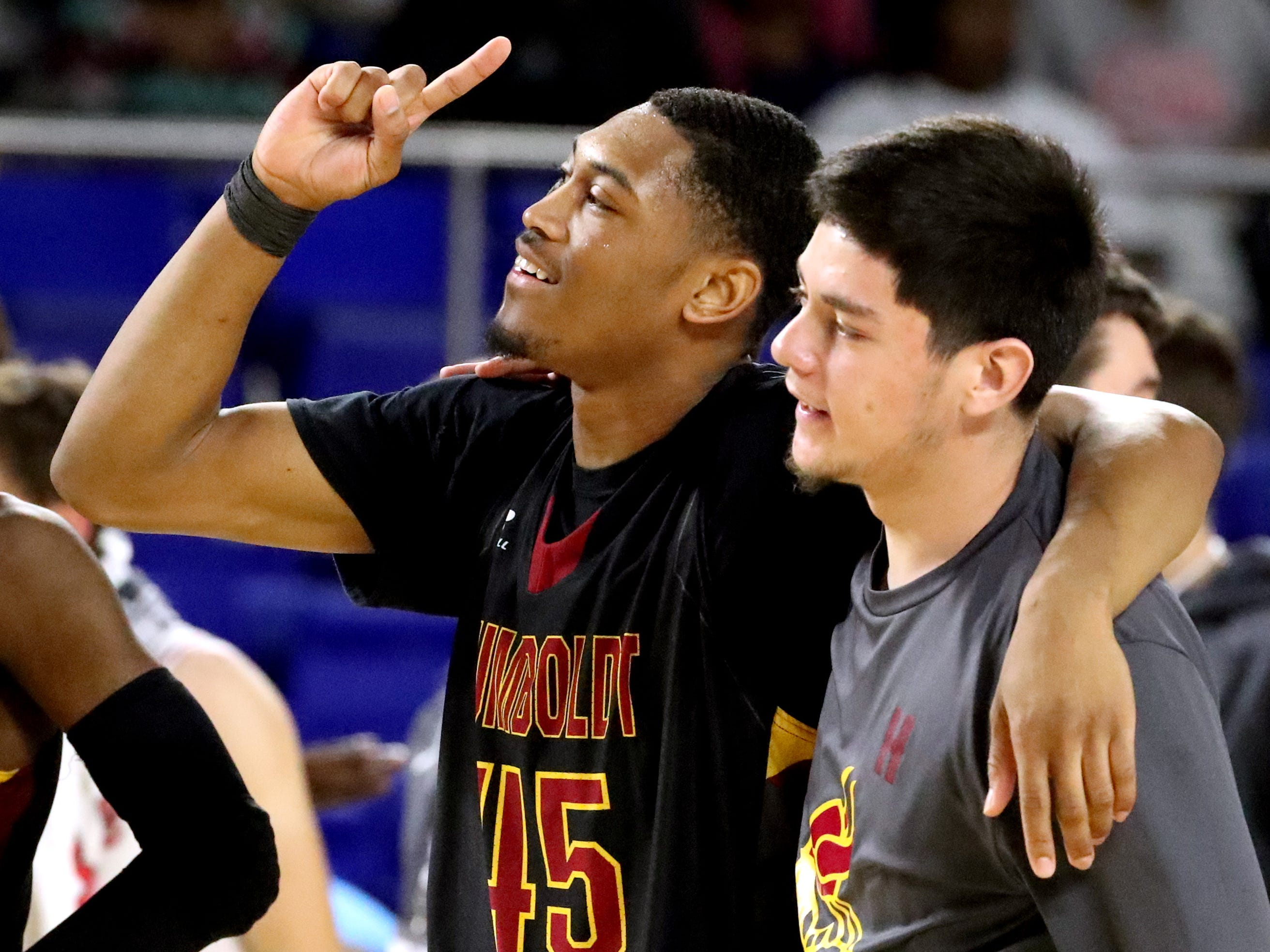 Humboldt's Anthony Jones (45) and Humboldt's Gabriel Bracamonte (1) celebrate beating McKenzie 66-55 in the semifinal round of the TSSAA Class A Boys State Tournament, on Thursday, March 15, 2019, at Murphy Center in Murfreesboro, Tenn.