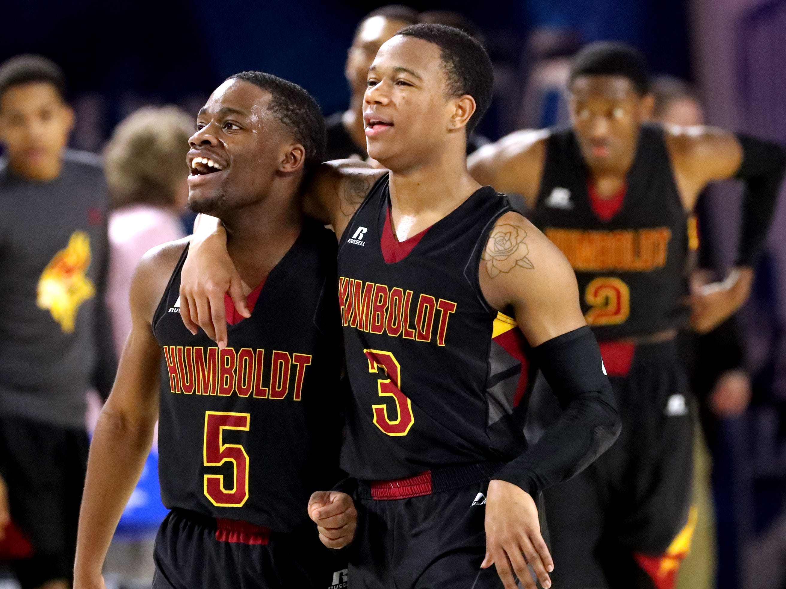 Humboldt's Montrez Ward (5) and Humboldt's Trent Green (3) celebrate beating McKenzie 66-55 in the semifinal round of the TSSAA Class A Boys State Tournament, on Thursday, March 15, 2019, at Murphy Center in Murfreesboro, Tenn.