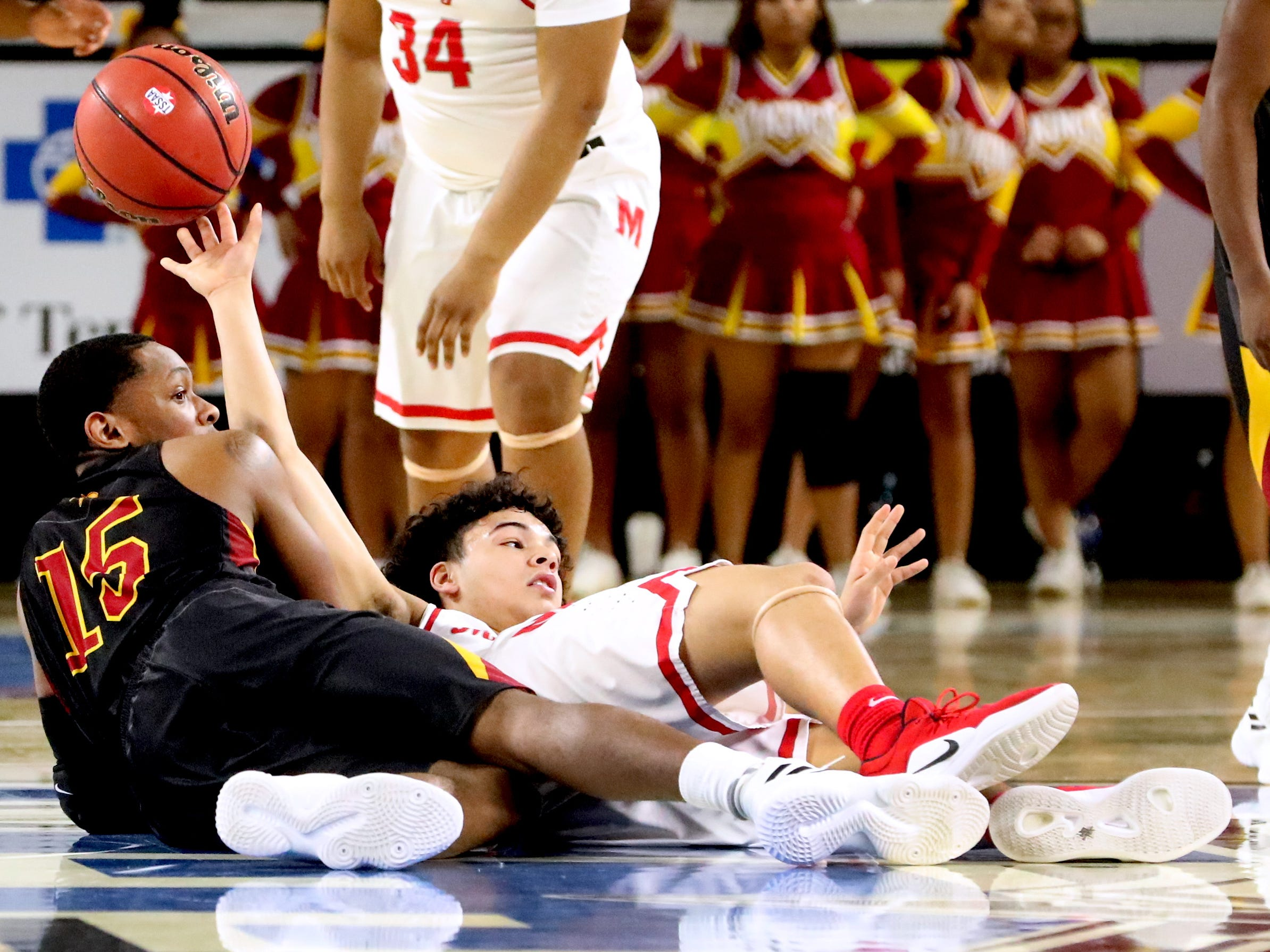 Humboldt's Malik Cox (15) and McKenzie's Lucas King (1) fall to the floor as King brings the ball up court during the semifinal round of the TSSAA Class A Boys State Tournament, on Thursday, March 15, 2019, at Murphy Center in Murfreesboro, Tenn.