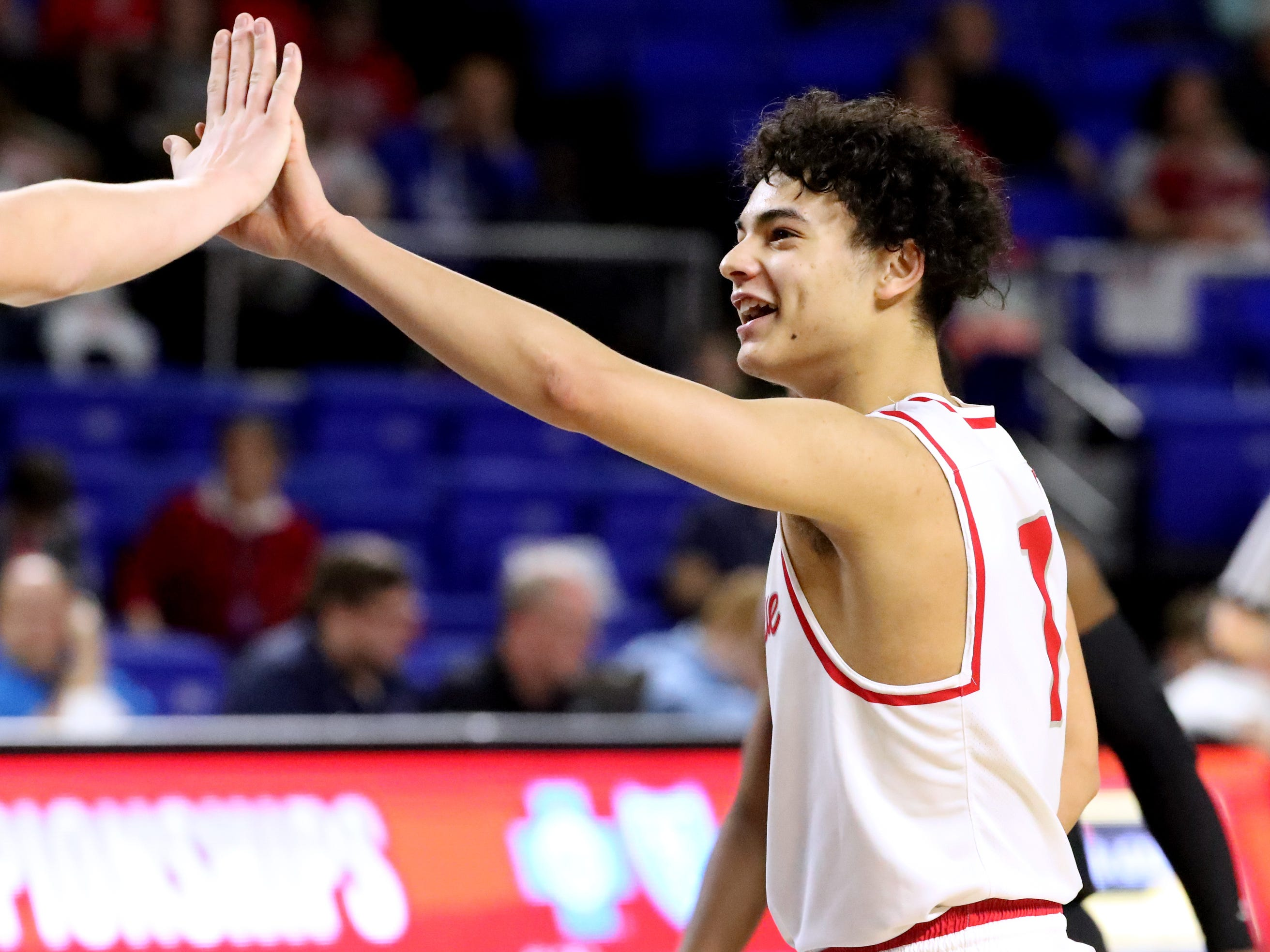 McKenzie's Lucas King (1) gives a high-five to senior McKenzie's Ben Austin (32) near the end of the semifinal round of the TSSAA Class A Boys State Tournament against Humboldt, on Thursday, March 15, 2019, at Murphy Center in Murfreesboro, Tenn.