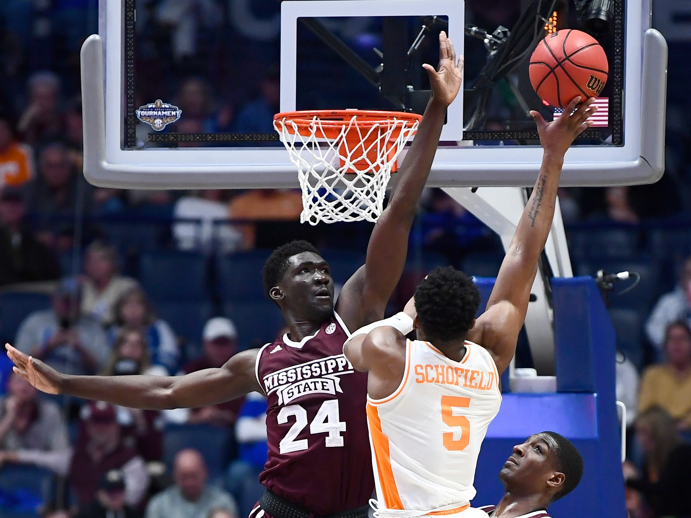Tennessee guard Admiral Schofield (5) shoots while defended by Mississippi State forward Abdul Ado (24) during the first half of the SEC Men's Basketball Tournament game at Bridgestone Arena in Nashville, Tenn., Friday, March 15, 2019.