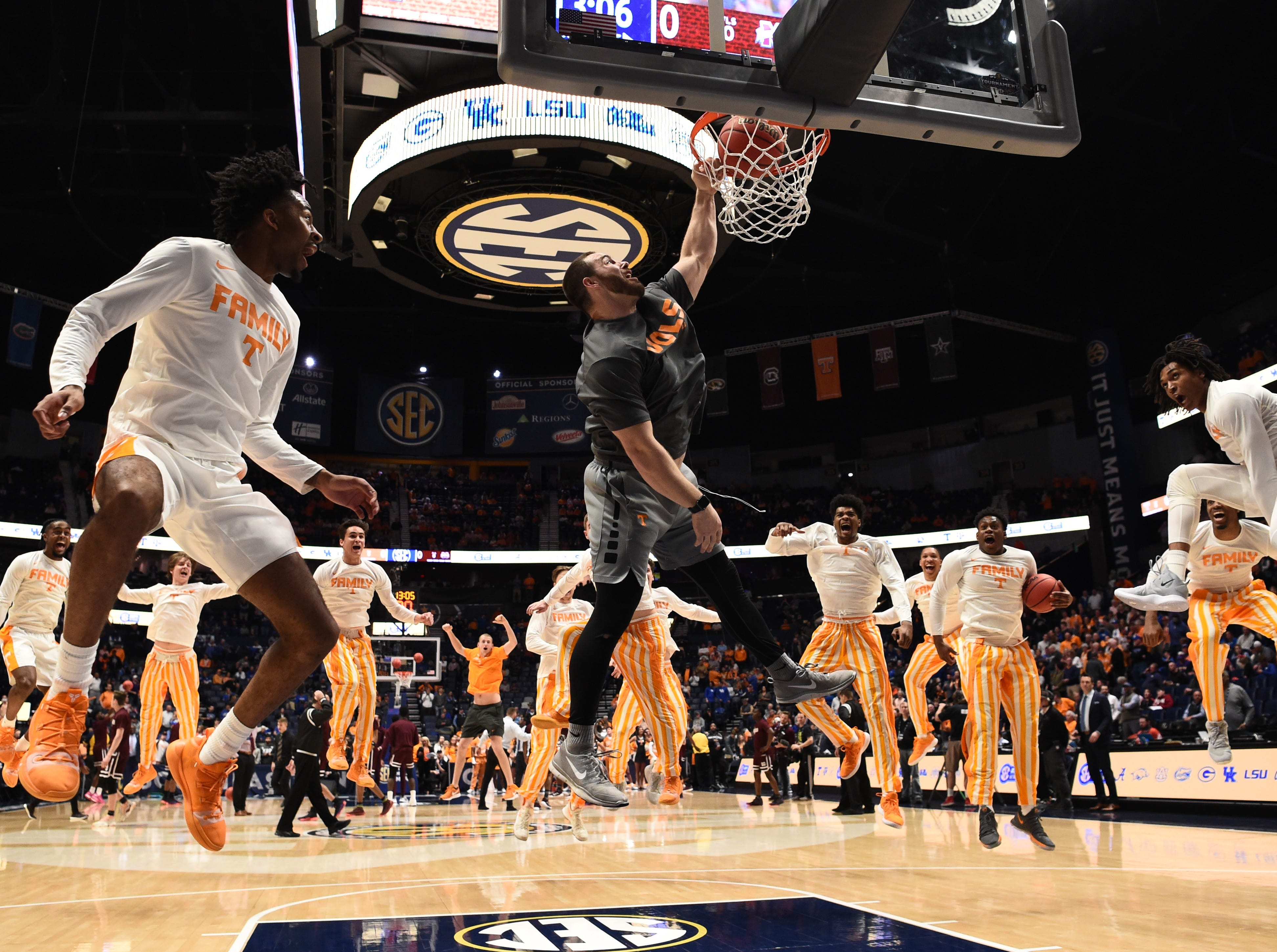 Tennessee players warm up before the SEC Men's Basketball Tournament game against Mississippi State at Bridgestone Arena in Nashville, Tenn., Friday, March 15, 2019.