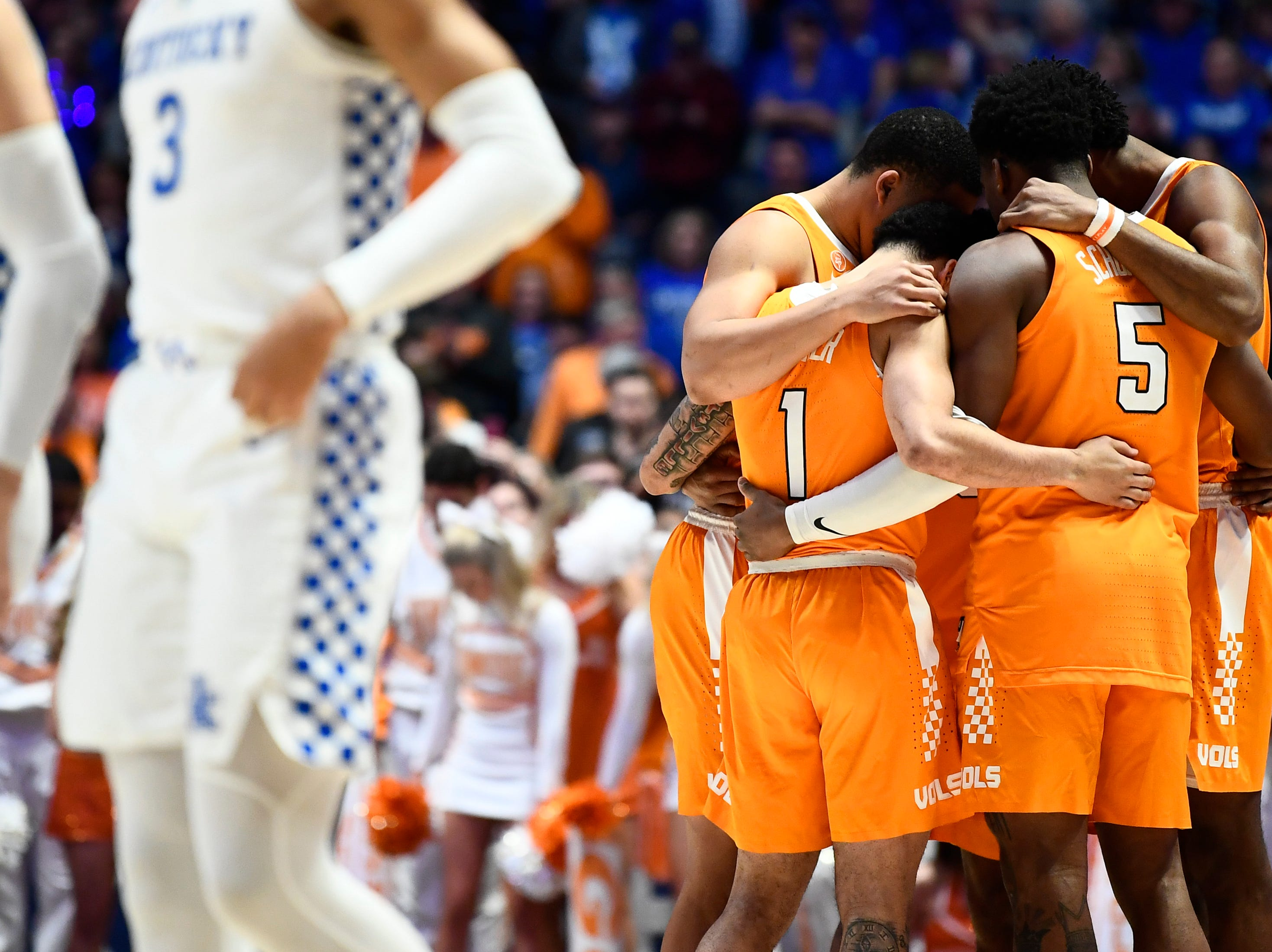 Tennessee players huddle before a SEC Men's Basketball Tournament semifinal game against Kentucky at Bridgestone Arena in Nashville, Tenn., Saturday, March 16, 2019.