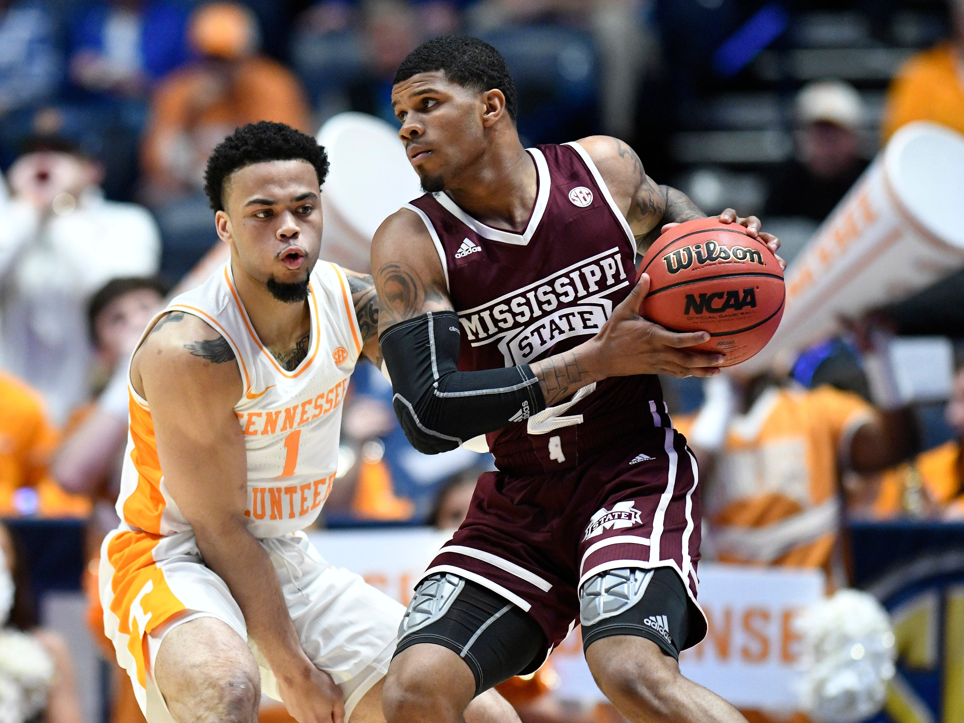 Mississippi State guard Lamar Peters (2) moves the ball defended by Tennessee guard Lamonte Turner (1) during the first half of the SEC Men's Basketball Tournament game at Bridgestone Arena in Nashville, Tenn., Friday, March 15, 2019.