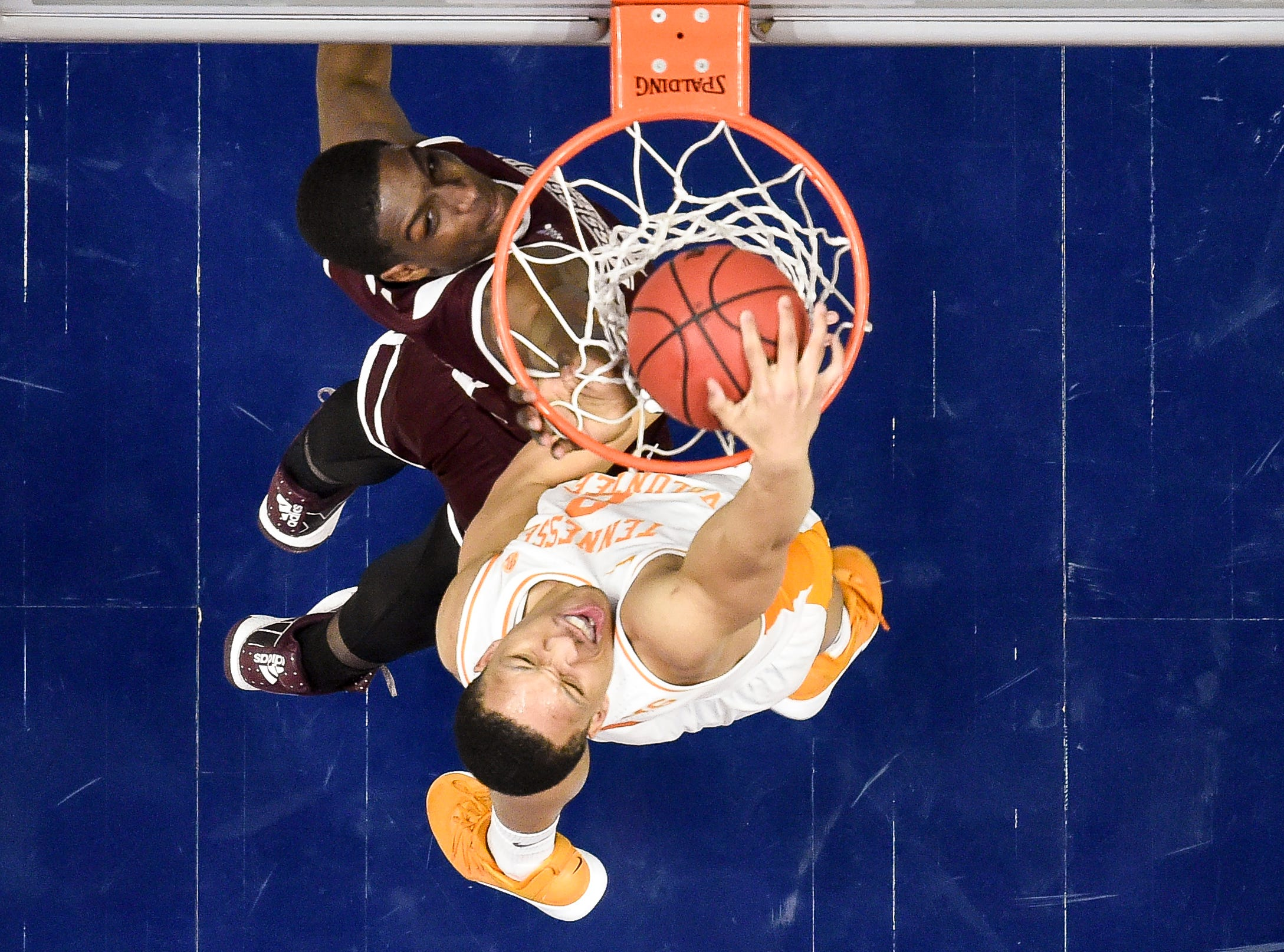 Tennessee forward Grant Williams (2) dunks over Mississippi State forward Reggie Perry (1) during the first half of the SEC Men's Basketball Tournament game at Bridgestone Arena in Nashville, Tenn., Friday, March 15, 2019.