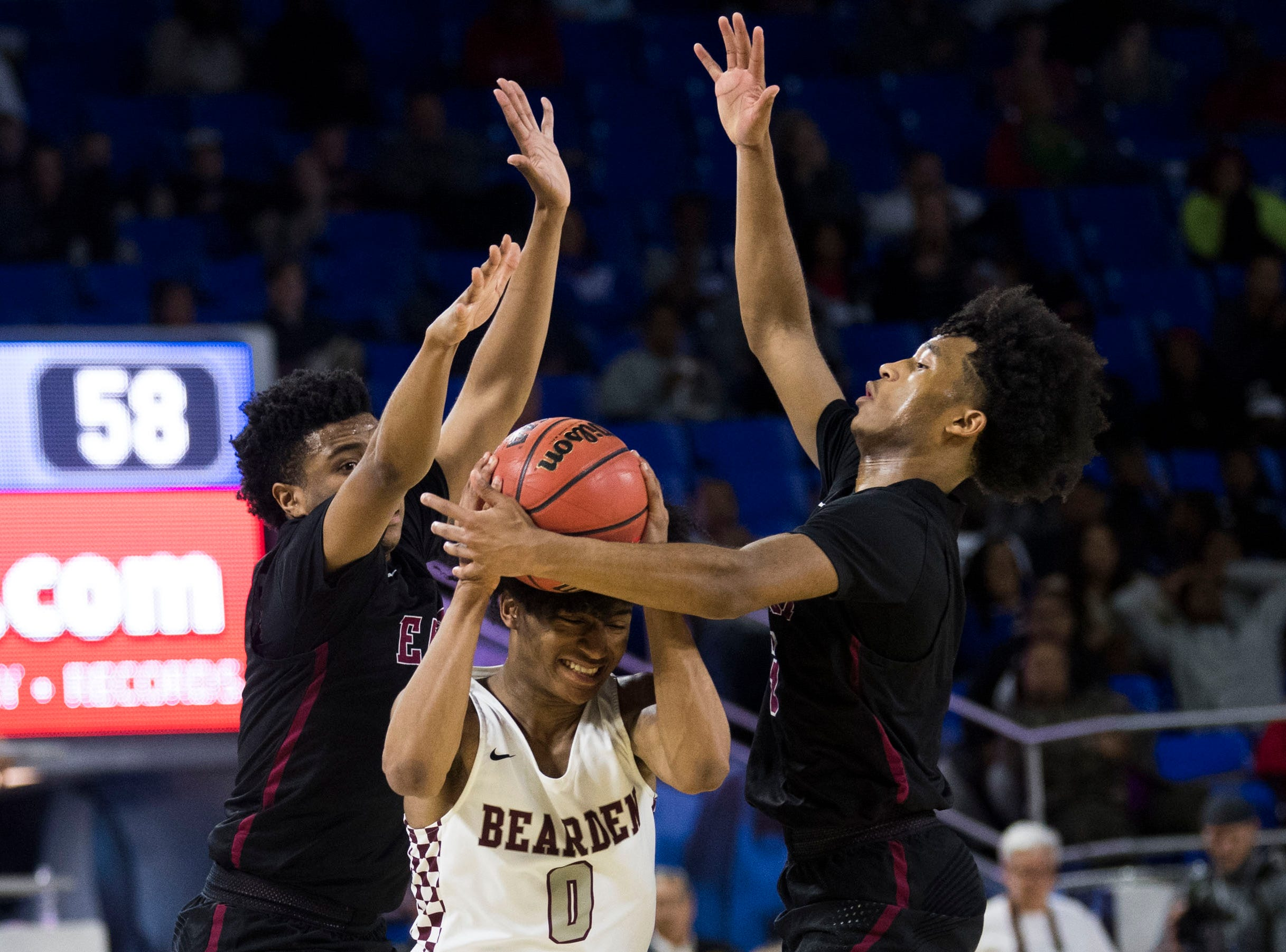 Bearden's Ques Glover (0) is defended by Memphis East during a TSSAA AAA state championship game at the Murphy Center in Murfreesboro, Saturday, March 16, 2019. Bearden defeated East 83-68.