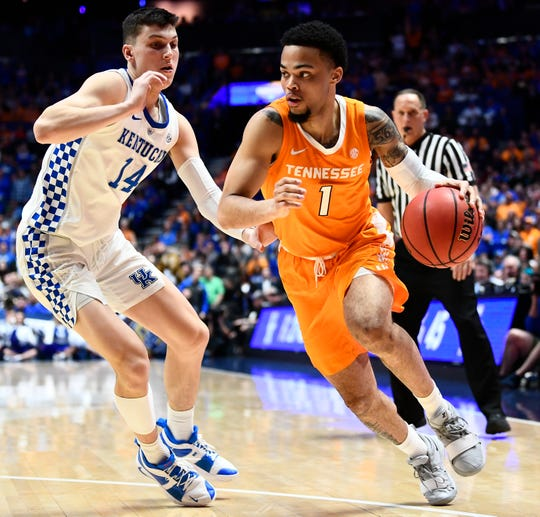 Tennessee guard Lamonte Turner (1) pushes into Kentucky guard Tyler Herro (14) during the second half of the SEC Men's Basketball Tournament semifinal game at Bridgestone Arena in Nashville, Tenn., Saturday, March 16, 2019.