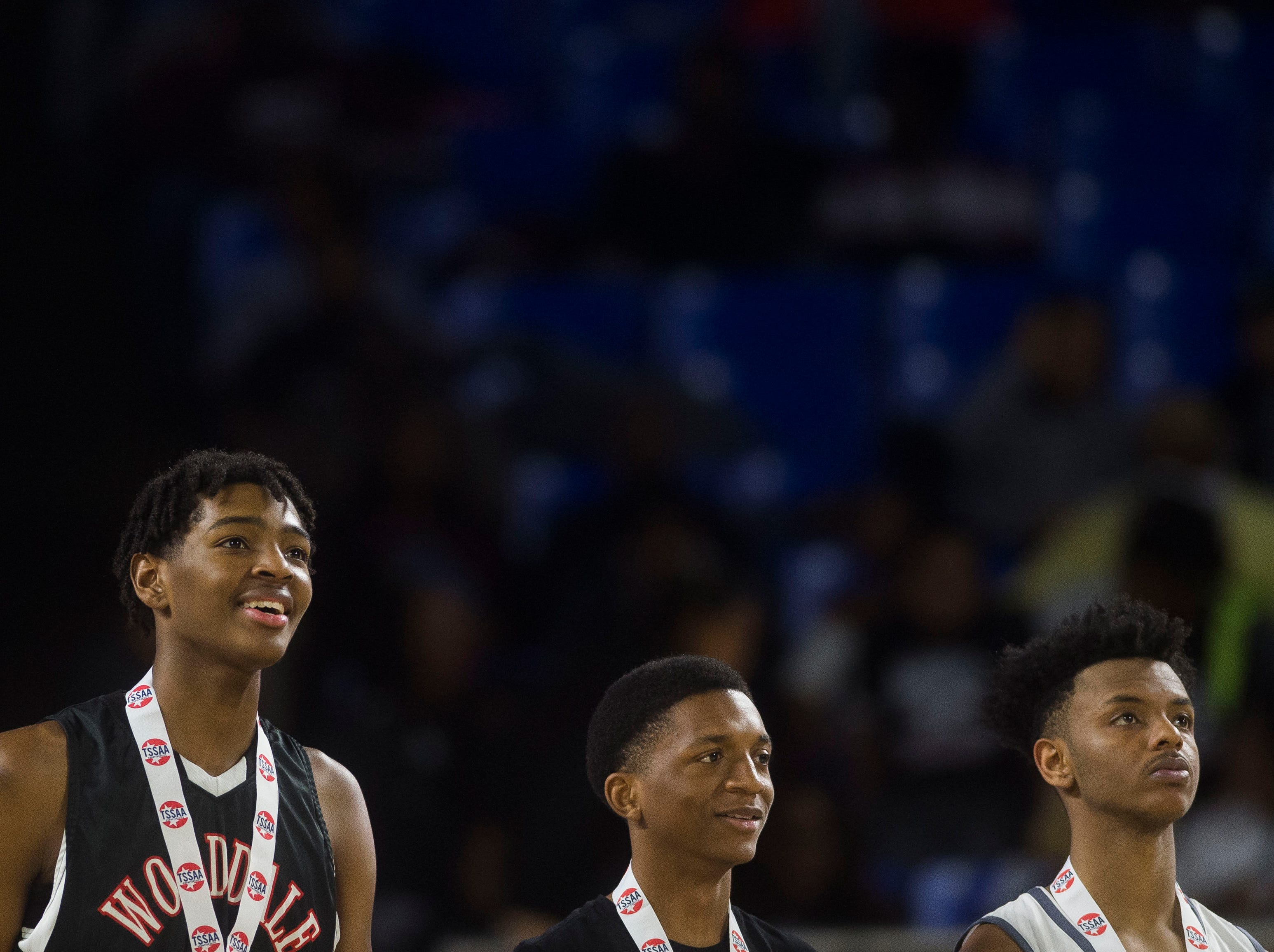 At right Fulton's Trey Davis (2) stands on the court after a TSSAA AA state championship game between Wooddale and Fulton at the Murphy Center in Murfreesboro, Saturday, March 16, 2019. Wooddale defeated Fulton 59-46.