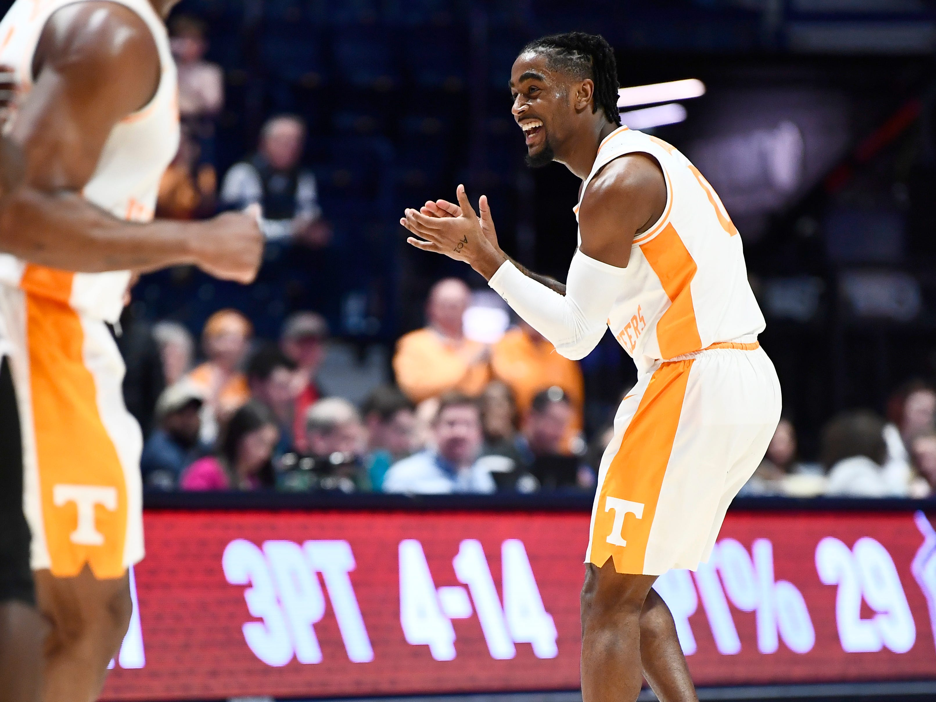 Tennessee guard Jordan Bone (0) celebrates his three-pointer during the second half of the SEC Men's Basketball Tournament game against Mississippi State at Bridgestone Arena in Nashville, Tenn., Friday, March 15, 2019.