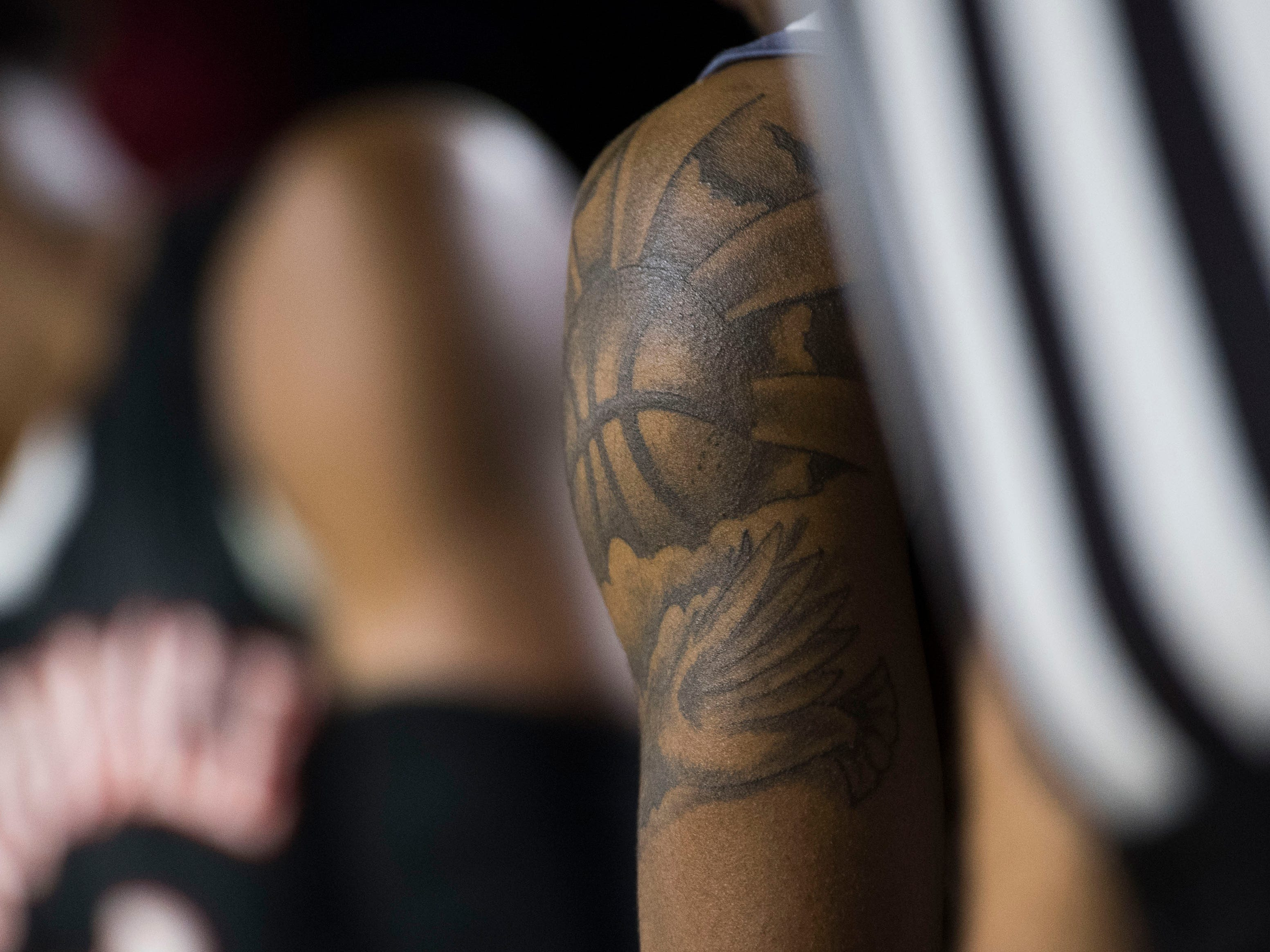 Fulton's Edward Lacy's tattoo is seen during a TSSAA AA state championship game between Wooddale and Fulton at the Murphy Center in Murfreesboro, Saturday, March 16, 2019.