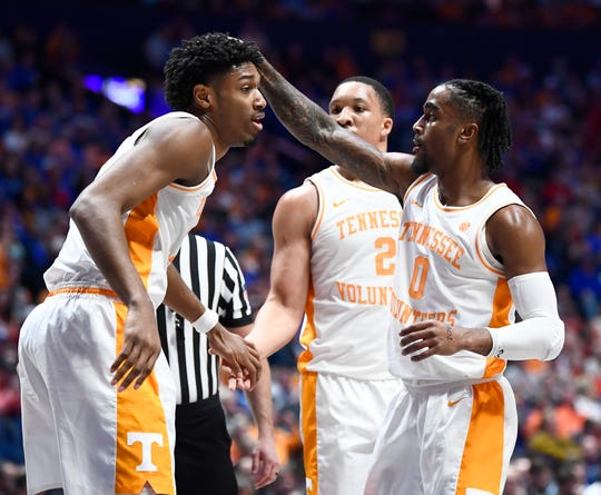 Tennessee forward Kyle Alexander (11), forward Grant Williams (2) and guard Jordan Bone (0) celebrate in the first half of the SEC Men's Basketball Tournament game against Mississippi State at Bridgestone Arena in Nashville, Tenn., Friday, March 15, 2019.