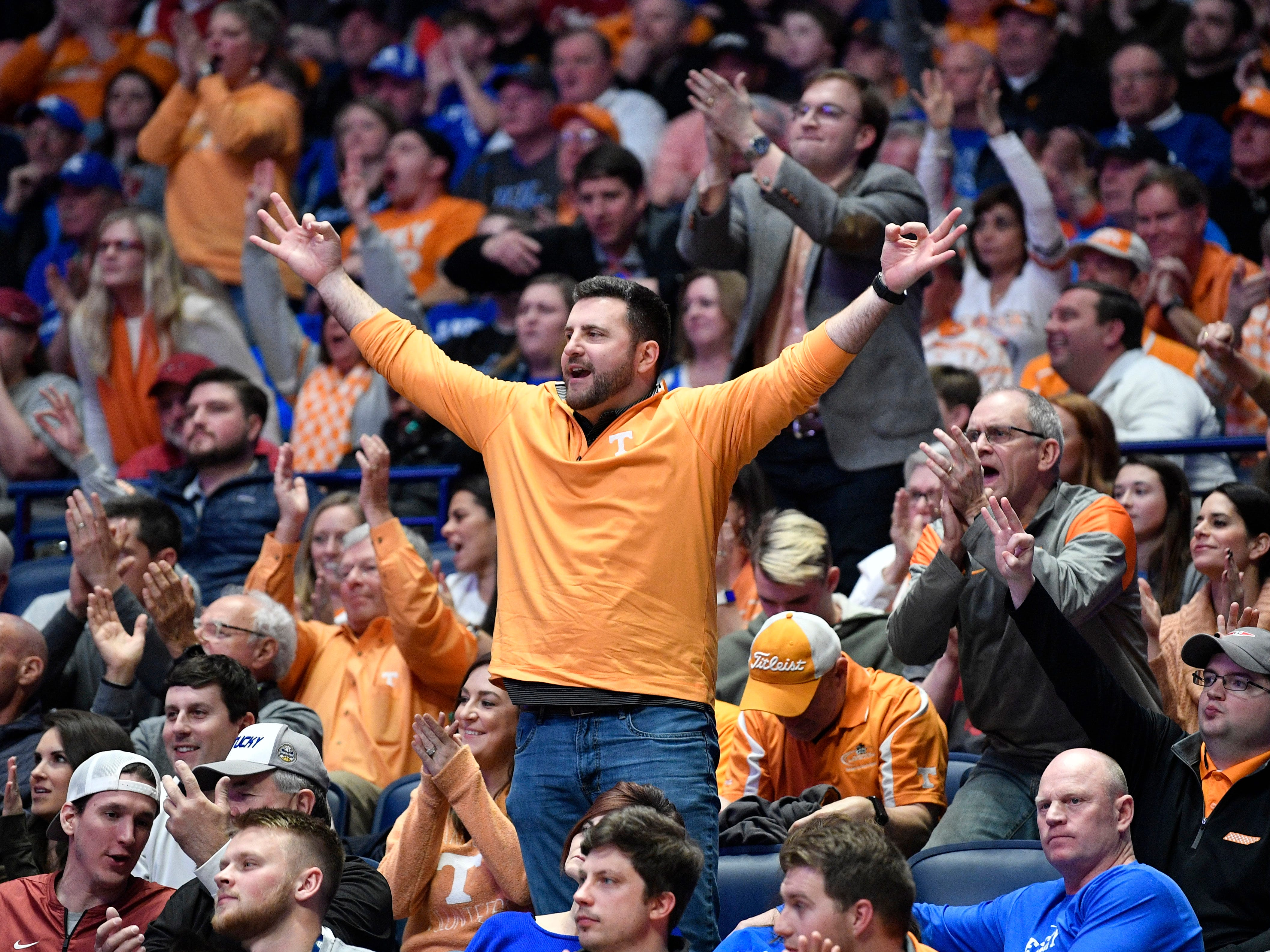 A UT fan cheers for the team against Mississippi State during the first half of their SEC Men's Basketball Tournament game at Bridgestone Arena in Nashville, Tenn., Friday, March 15, 2019.